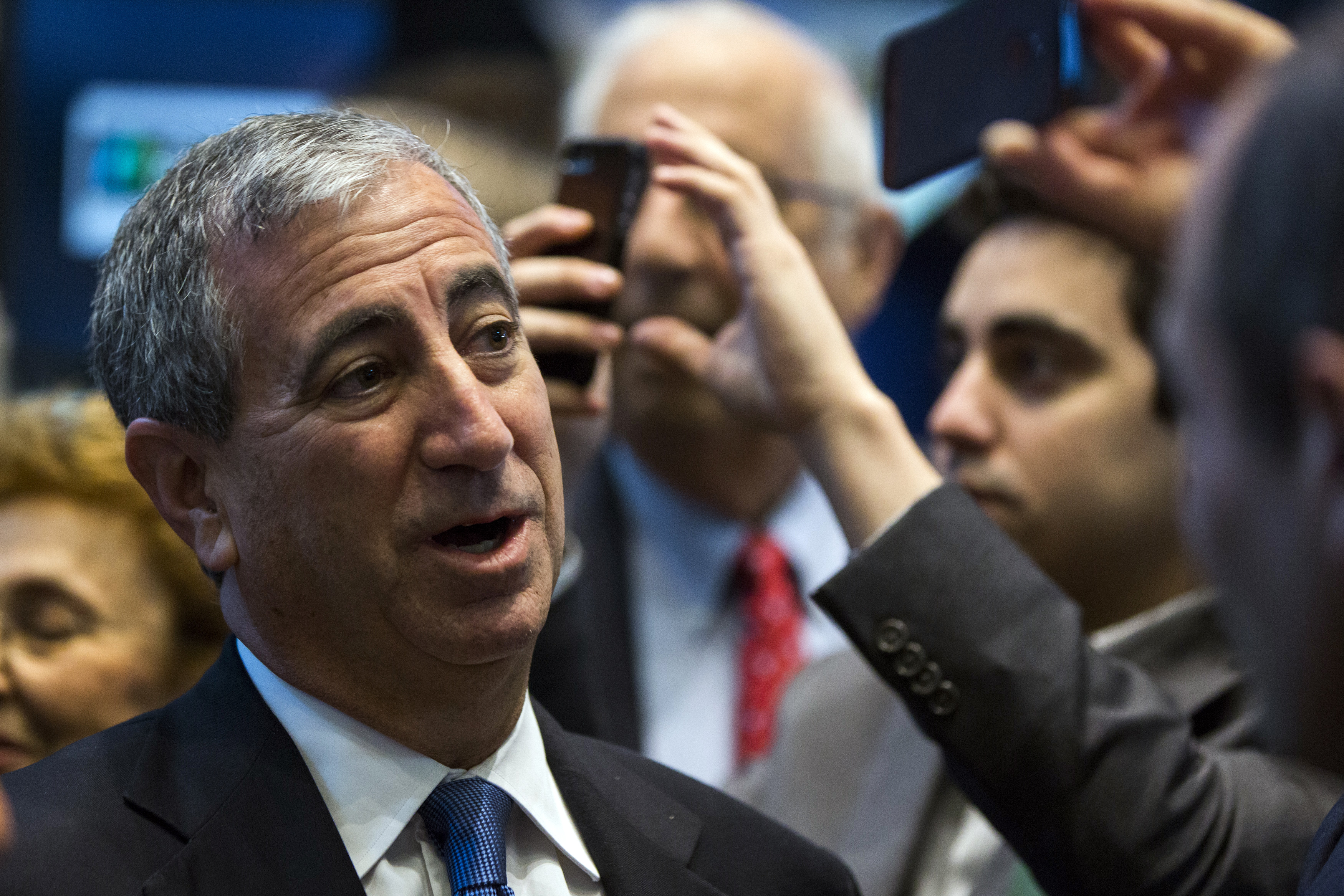 Chief executive officer of Moelis & Co., Ken Moelis smiles after ringing the bell to mark the company