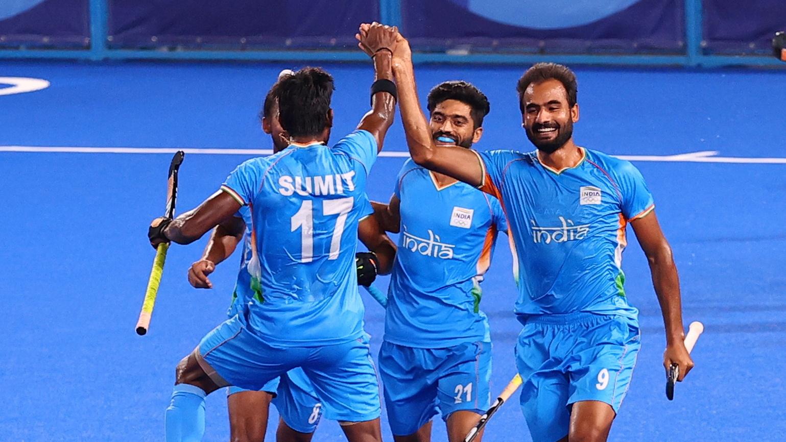 Tokyo 2020 Olympics - Hockey - Men - Quarterfinal - India v Britain - Oi Hockey Stadium, Tokyo, Japan - August 1, 2021. Gurjant Singh of India celebrates with teammates after scoring. REUTERS/Bernadett Szabo