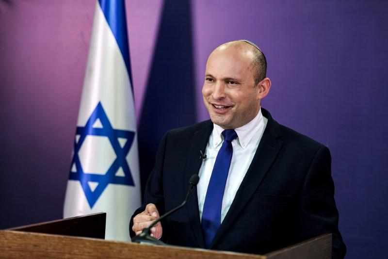 Naftali Bennett, Israeli parliament member from the Yamina party, gives a statement at the Knesset, Israel's parliament, in Jerusalem, June 6, 2021. Menahem Kahana/Pool via REUTERS/File Photo