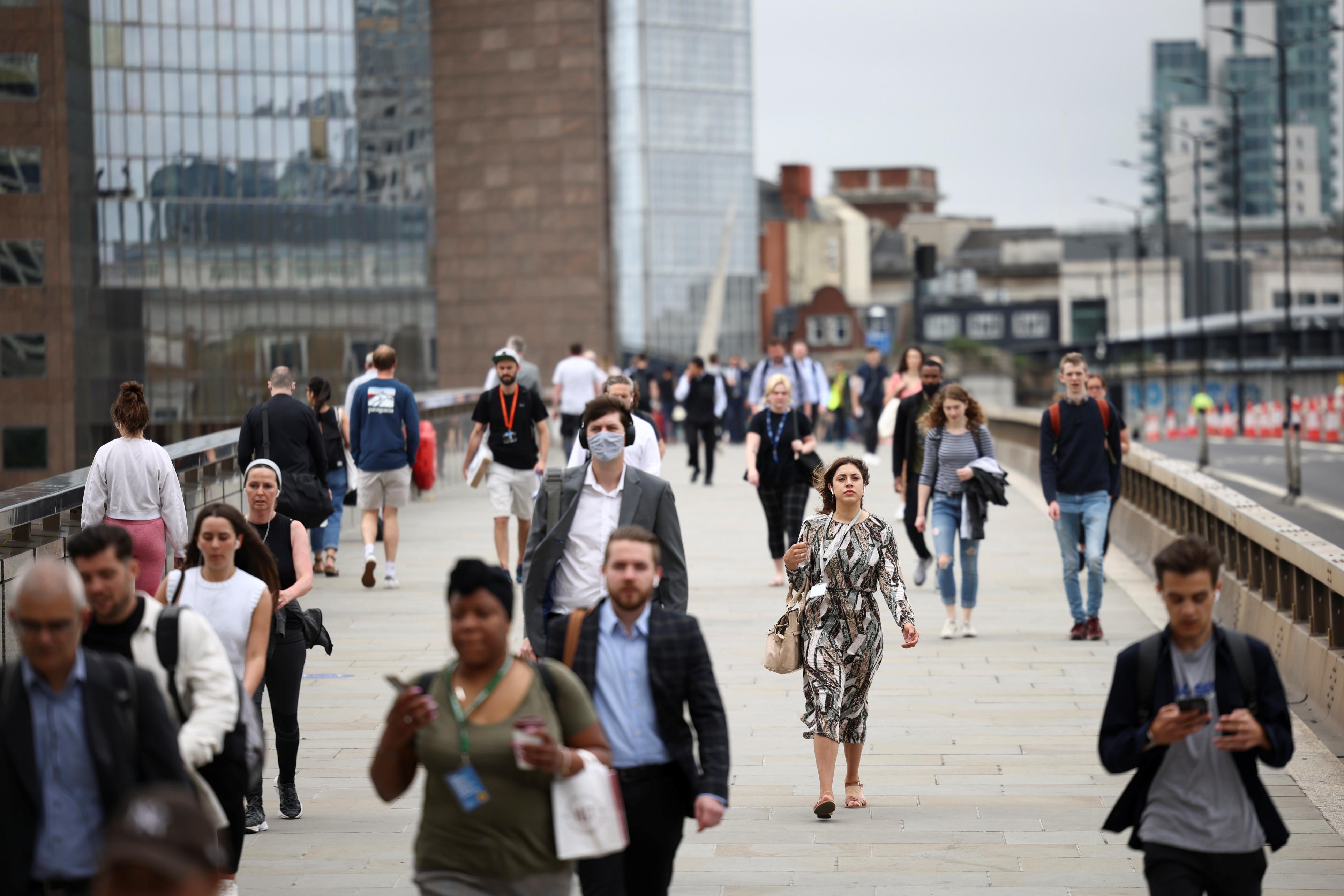 People walk across London Bridge during morning rush hour, in London, Britain, June 11, 2021. REUTERS/Henry Nicholls