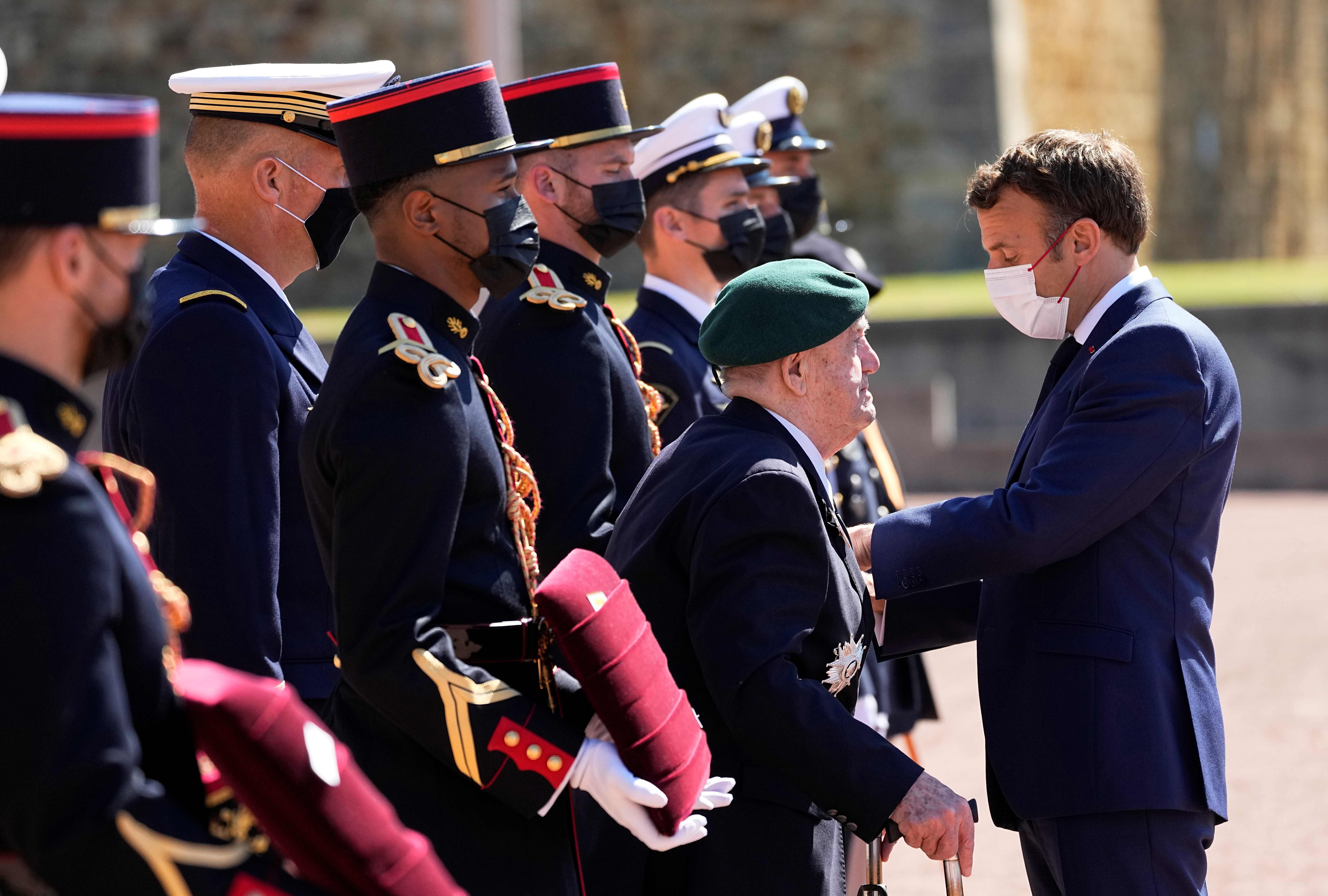 WWII French veterans Leon Gautier, 98 years old last survivor of the  Kieffer Commando, is honored by French President Emmanuel Macron with the Legion of Honor during a WWII ceremony to mark the 81st anniversary of late French Gen. Charles de Gaulle's resistance call from London on June 18, 1940, at the Mont Valerien, in Suresnes, near Paris, France, June 18, 2021. Michel Euler/Pool via REUTERS