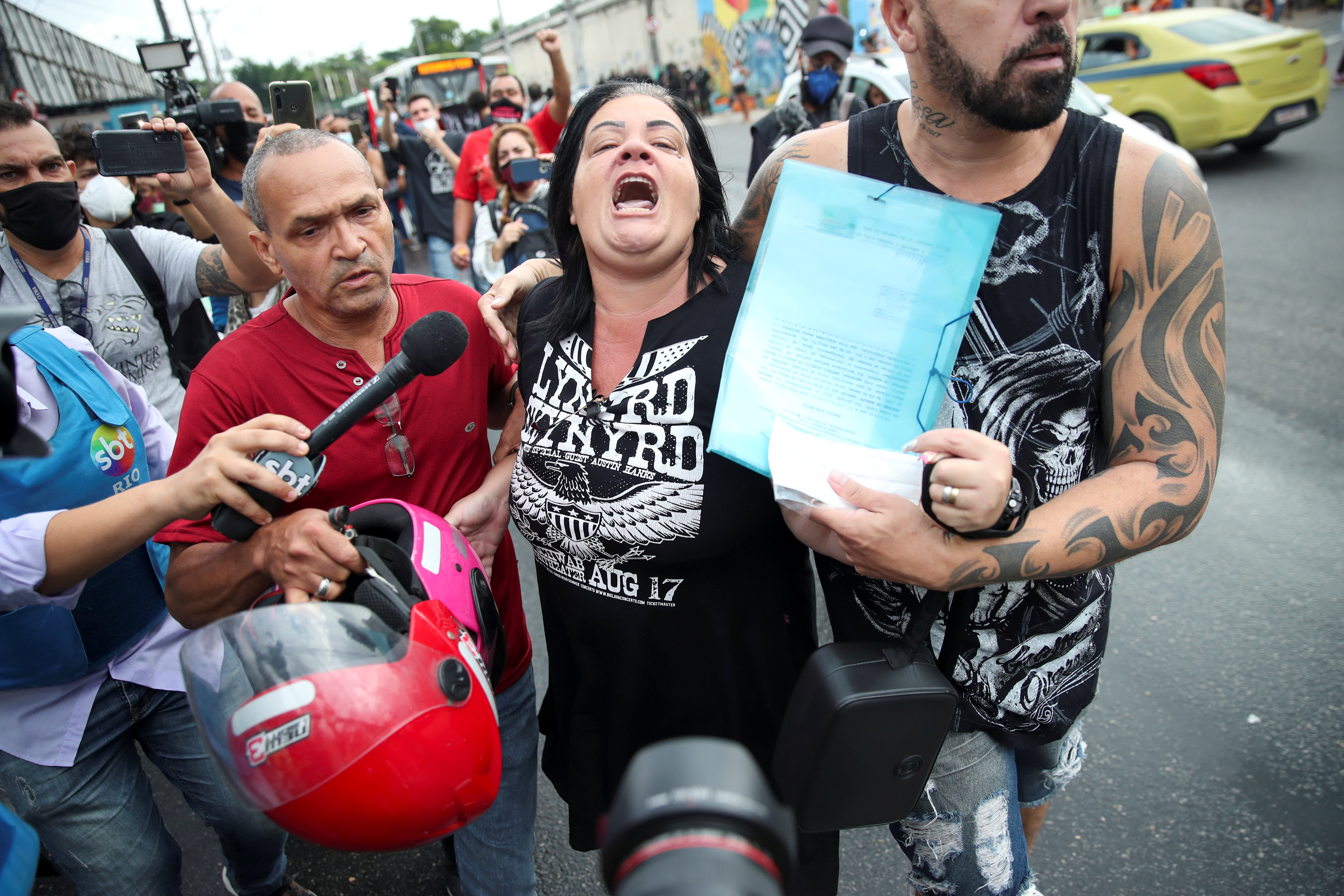Adriana Santana de Araujo, 46, mother of Marlon Santana de Araujo, 23, one of the victims, reacts during a protest against police violence outside Jacarezinho slum, after a police operation which resulted in 25 deaths, in Rio de Janeiro, Brazil, May 7, 2021. REUTERS/Ricardo Moraes
