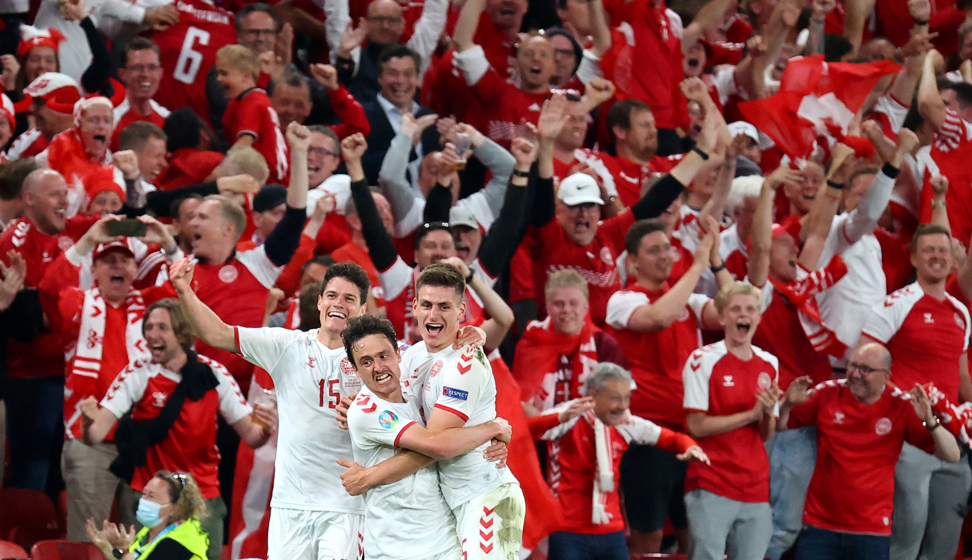 Denmark's Joakim Maehle celebrates scoring their fourth goal with Thomas Delaney and Christian Norgaard against Russia during Euro 2020 at Parken Stadium, Copenhagen, Denmark, June 21, 2021. Pool via REUTERS/Wolfgang Rattay