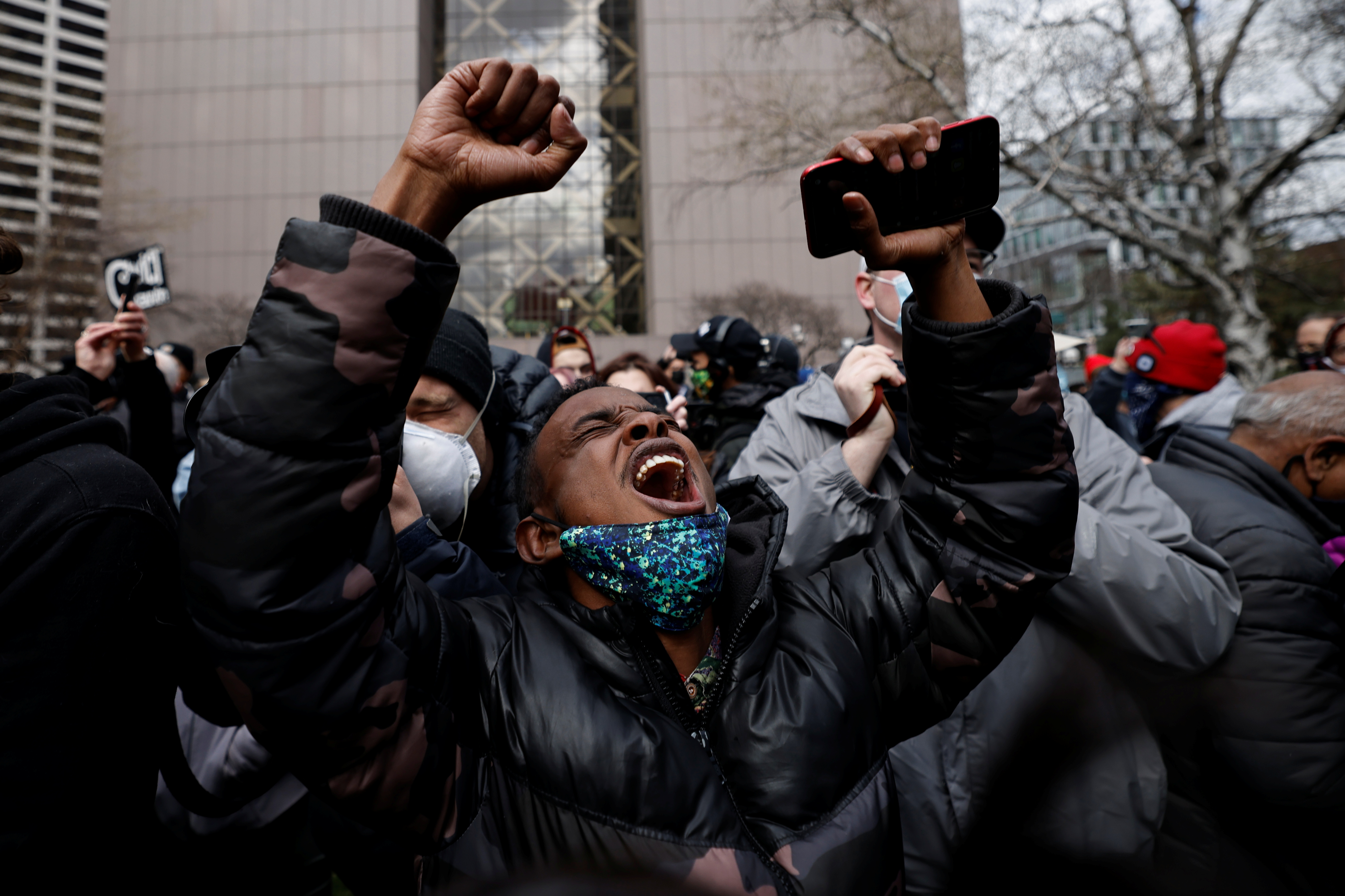 A person reacts after the verdict in the trial of former Minneapolis police officer Derek Chauvin, in the death of George Floyd, in front of Hennepin County Government Center, in Minneapolis, Minnesota, U.S., April 20, 2021. REUTERS/Carlos Barria