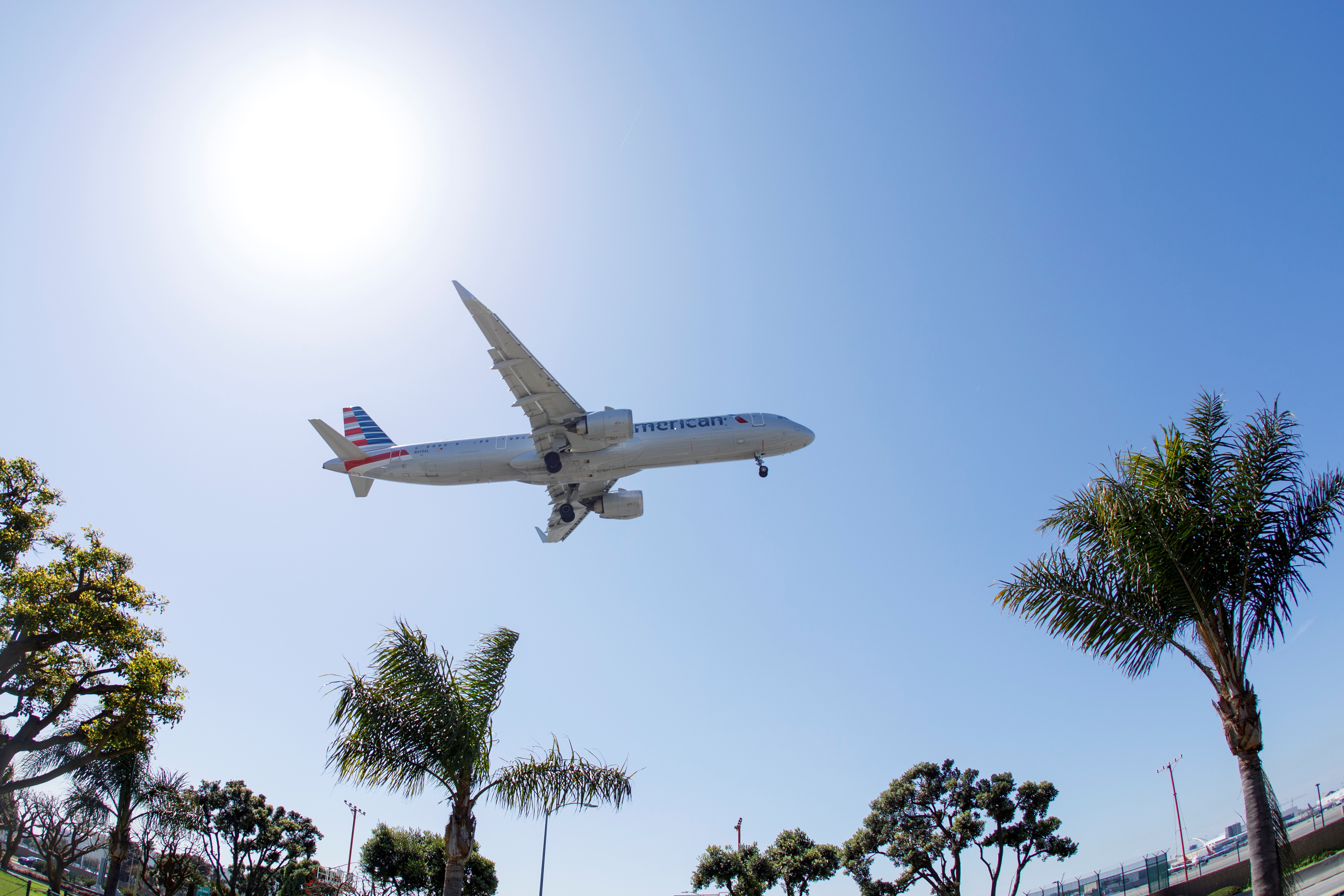An American Airlines passenger jet approaches to land at LAX during the outbreak of the coronavirus disease (COVID-19) in Los Angeles, California, U.S., April 7, 2021. REUTERS/Mike Blake
