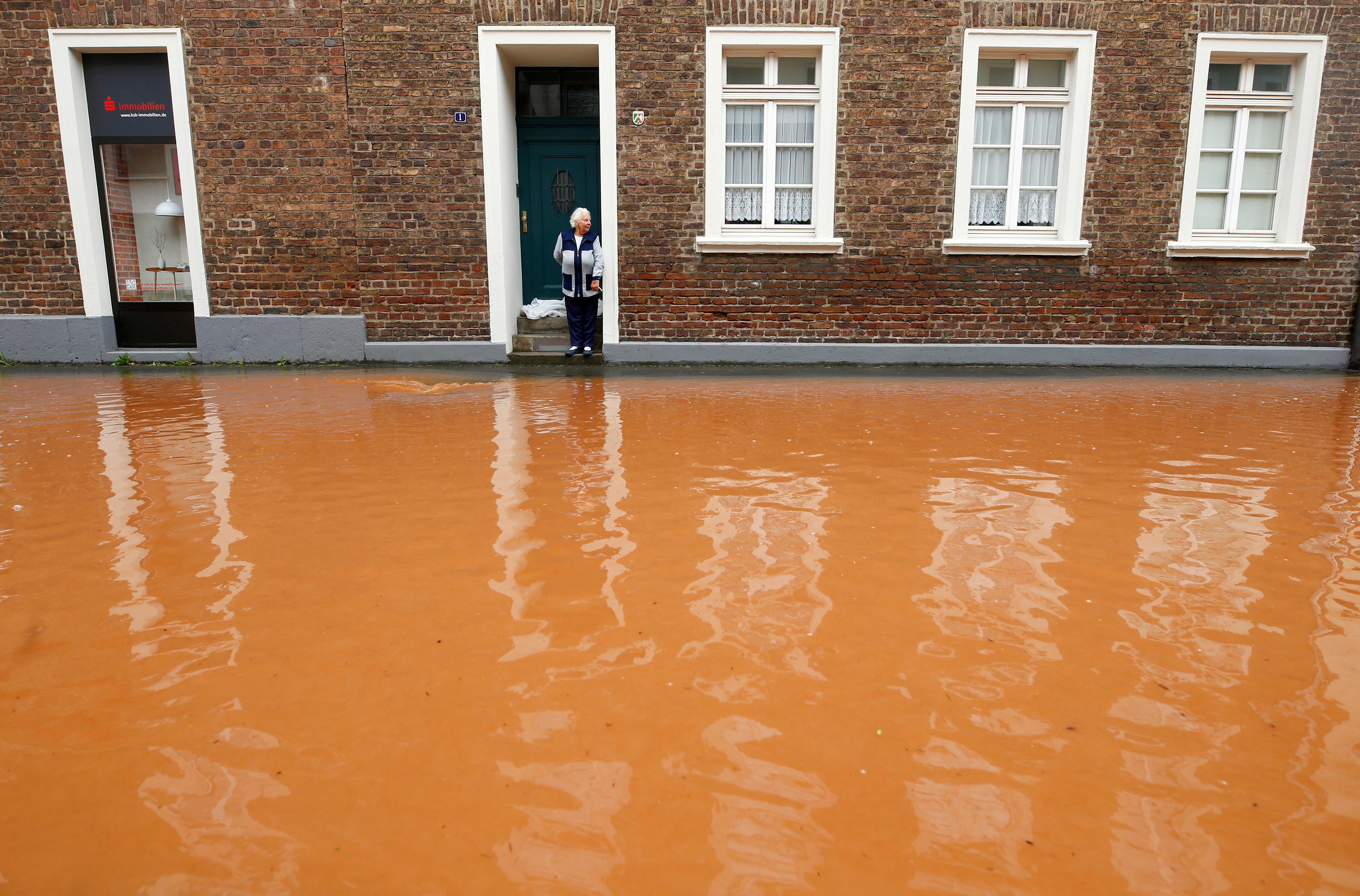 A street is flooded following heavy rainfalls in Erftstadt, Germany, July 16, 2021. REUTERS/Thilo Schmuelgen/File Photo