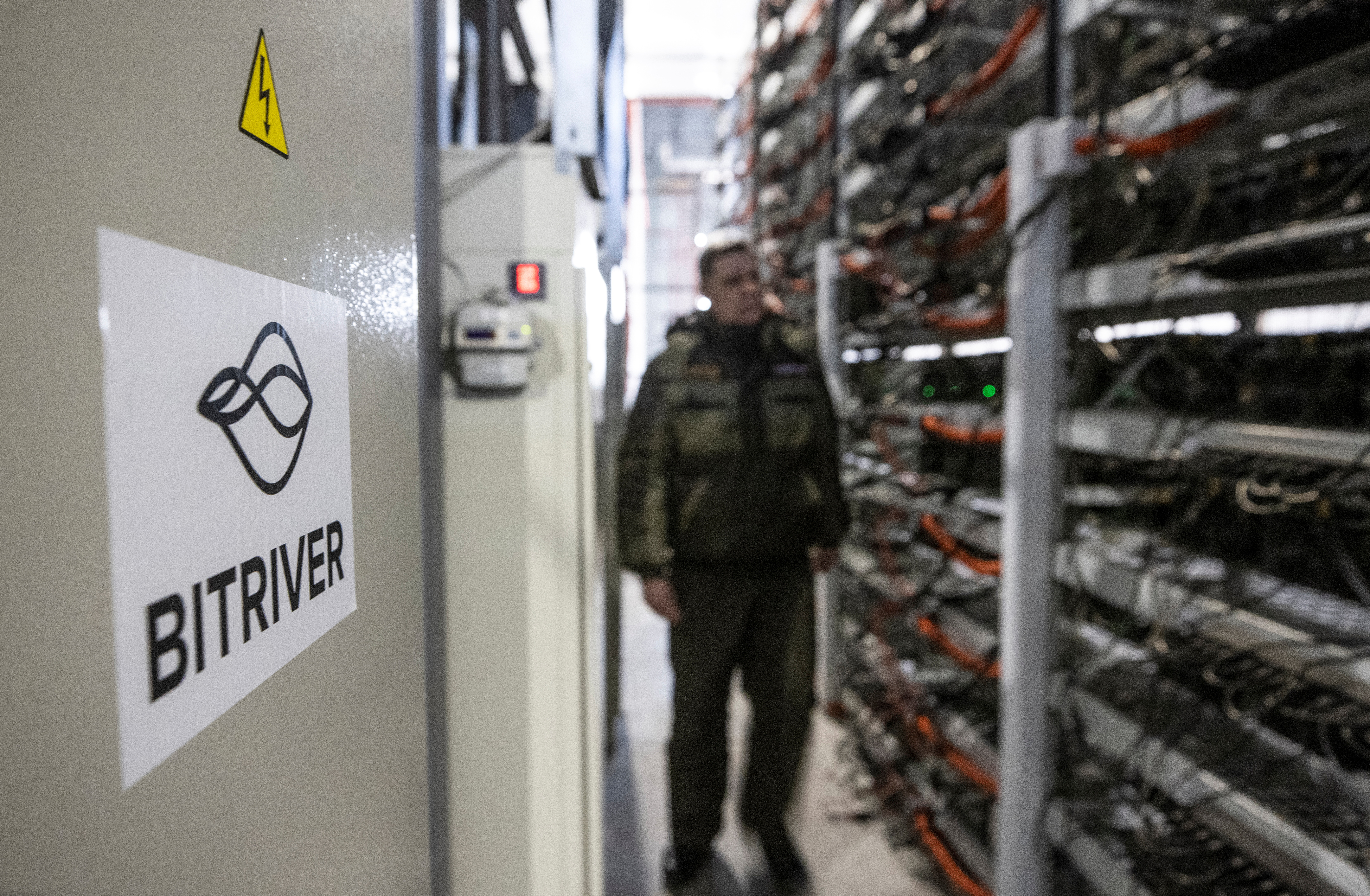 A view shows the data centre of BitRiver company providing services for cryptocurrency mining in the city of Bratsk in Irkutsk Region, Russia March 2, 2021. BitRiver offers hosting services and turnkey solutions for cryptocurrency mining operations to institutional investors including bitcoin mining firms. Picture taken March 2, 2021. REUTERS/Maxim Shemetov