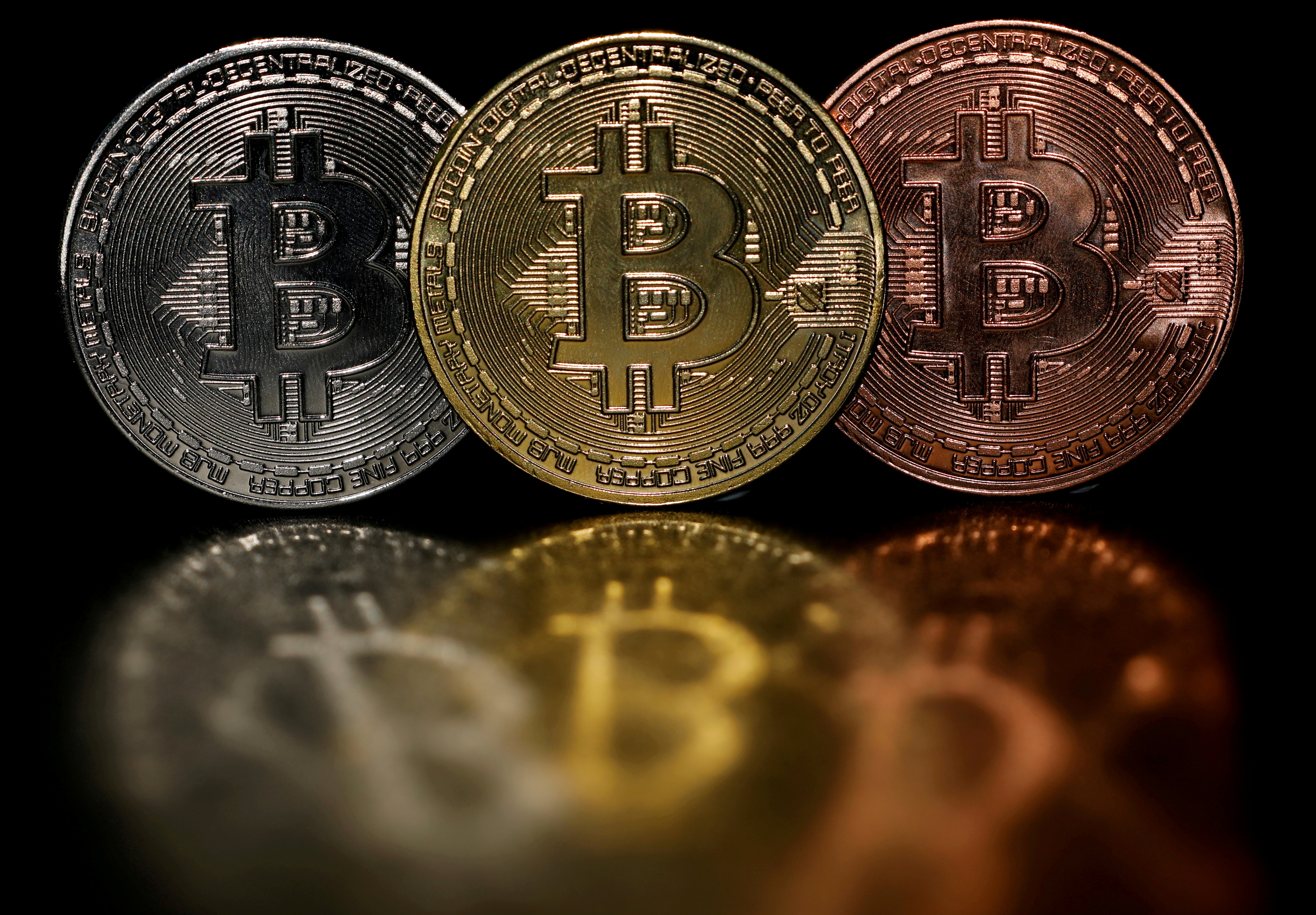 Representations of cryptocurrency Bitcoin are seen in this picture illustration taken June 7, 2021. REUTERS/Edgar Su/Illustration/File Photo