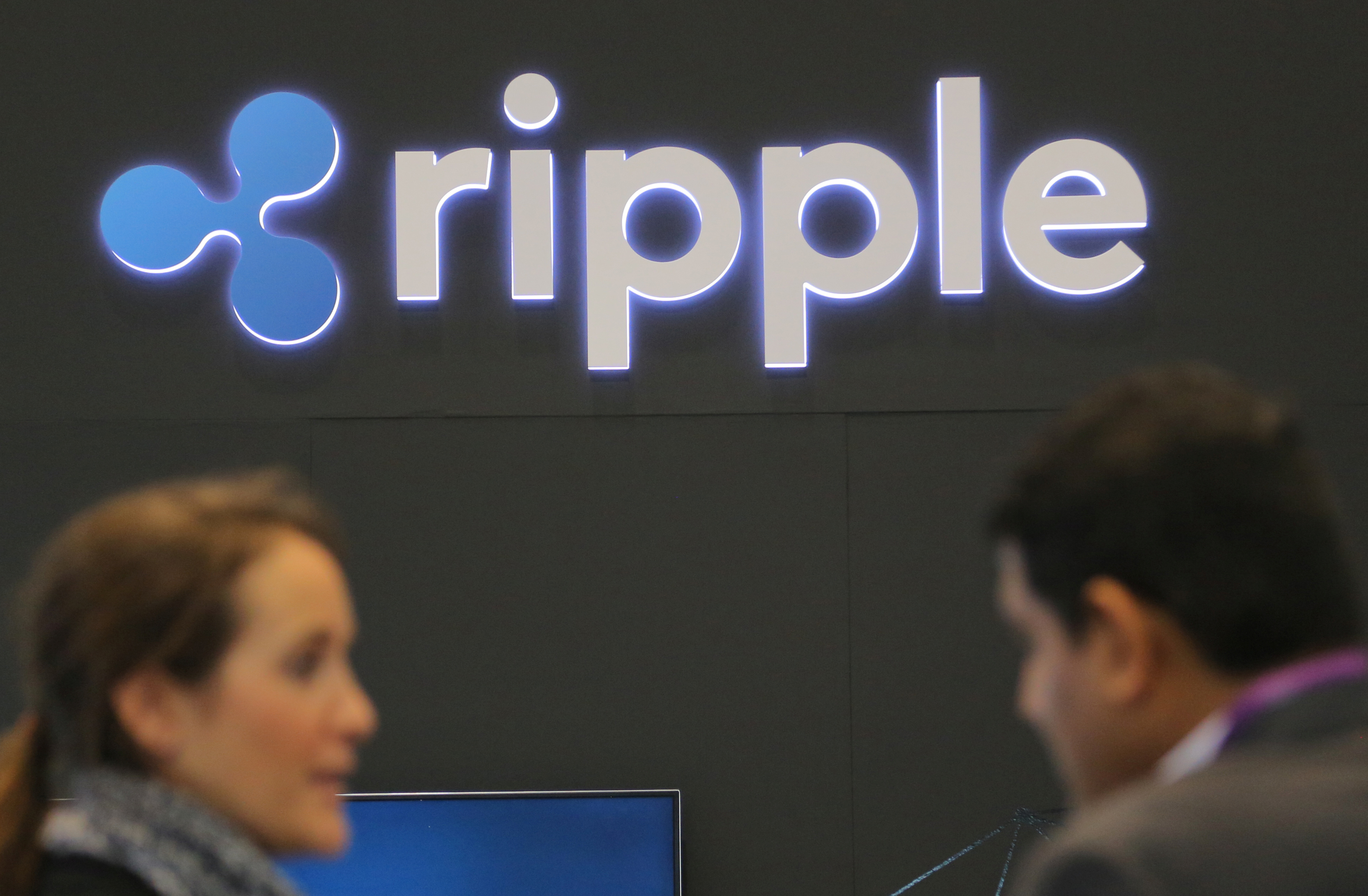 The logo of blockchain company Ripple is seen at the SIBOS banking and financial conference in Toronto, Ontario, Canada October 19, 2017. REUTERS/Chris Helgren/File Photo