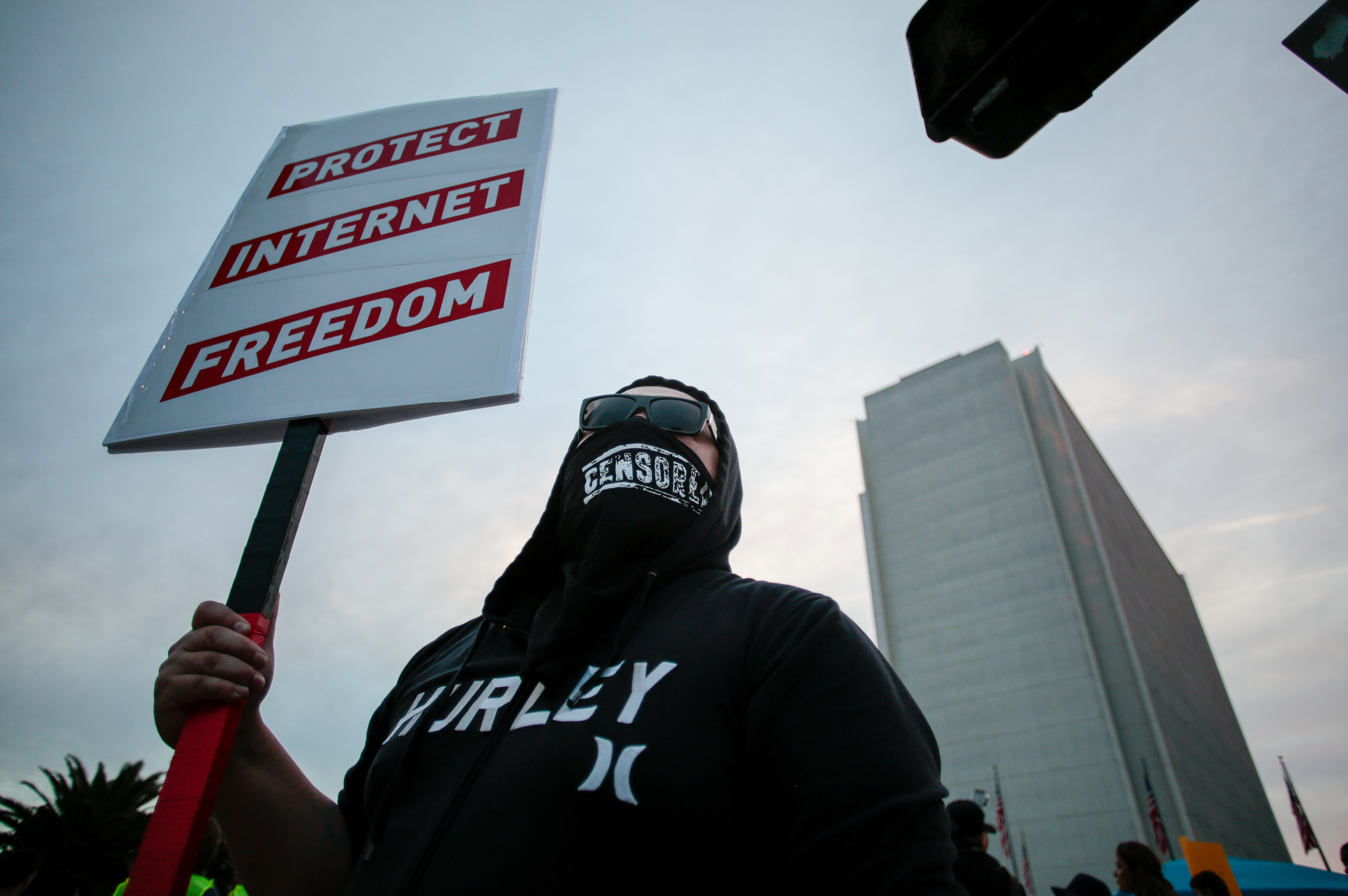 Supporter of Net Neutrality Lance Brown Eyes protests the FCC's recent decision to repeal the program in Los Angeles, California, November 28, 2017. REUTERS/ Kyle Grillot/Files