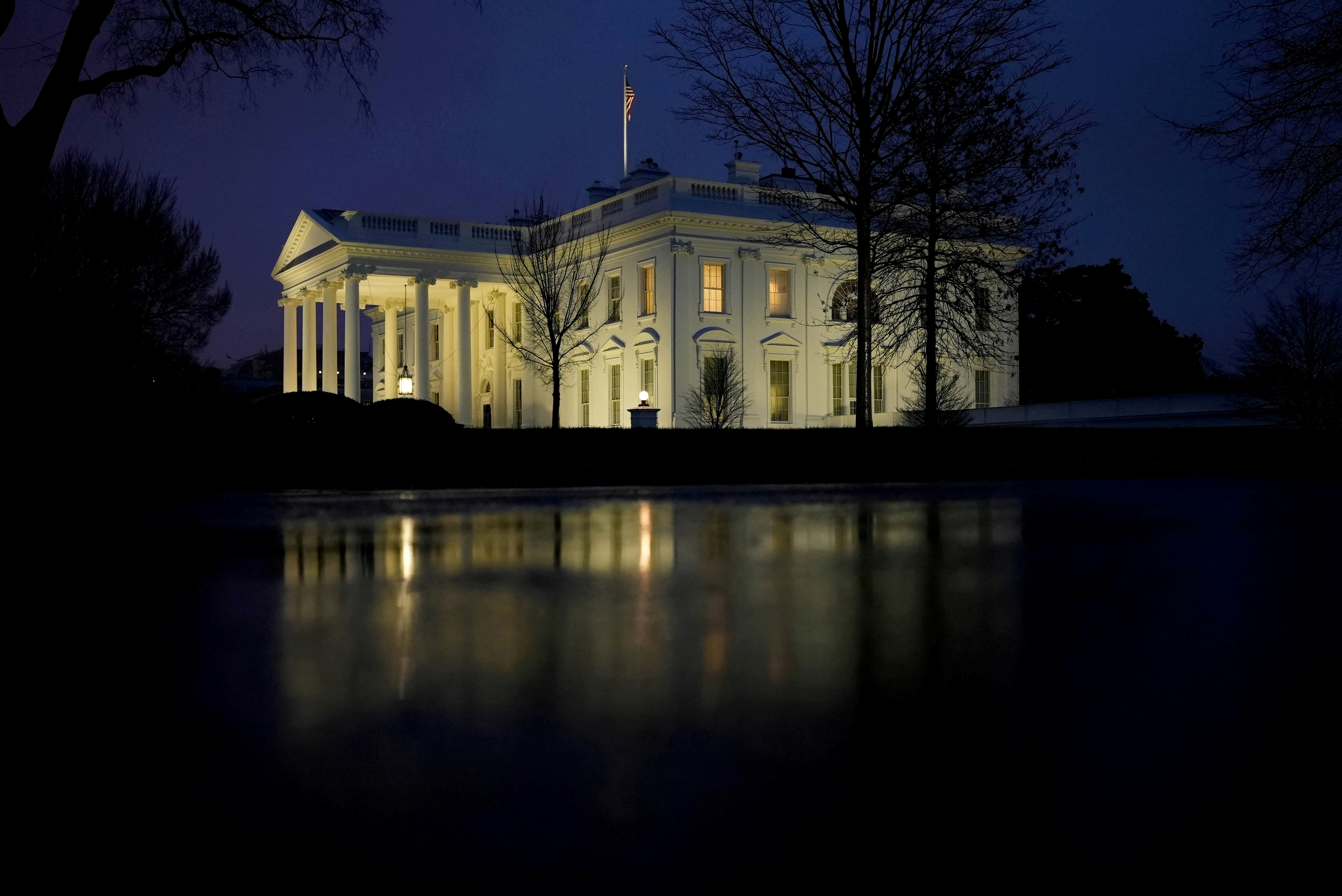 The White House is seen on the day when the Senate handed U.S. President Trump the first veto override of his presidency, passing the National Defense Authorization Act. in Washington, D.C., U.S. January 1, 2021. REUTERS/Ken Cedeno     TPX IMAGES OF THE DAY/File Photo