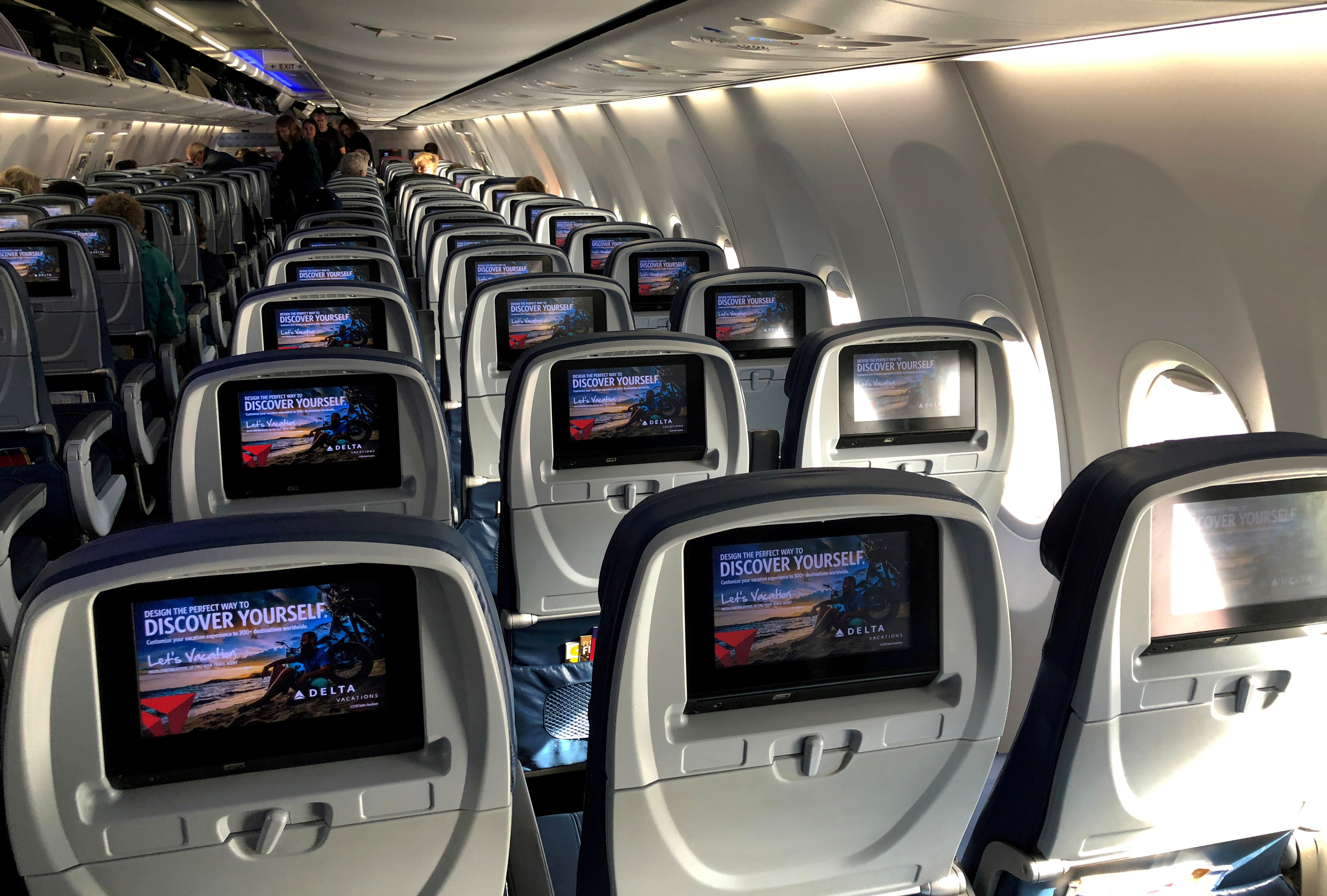 Video screens are shown built into the backs of passenger seats on board a Delta Airlines Boeing 737-900ER aircraft in San Diego, California, U.S., January 10, 2018.  REUTERS/Mike Blake