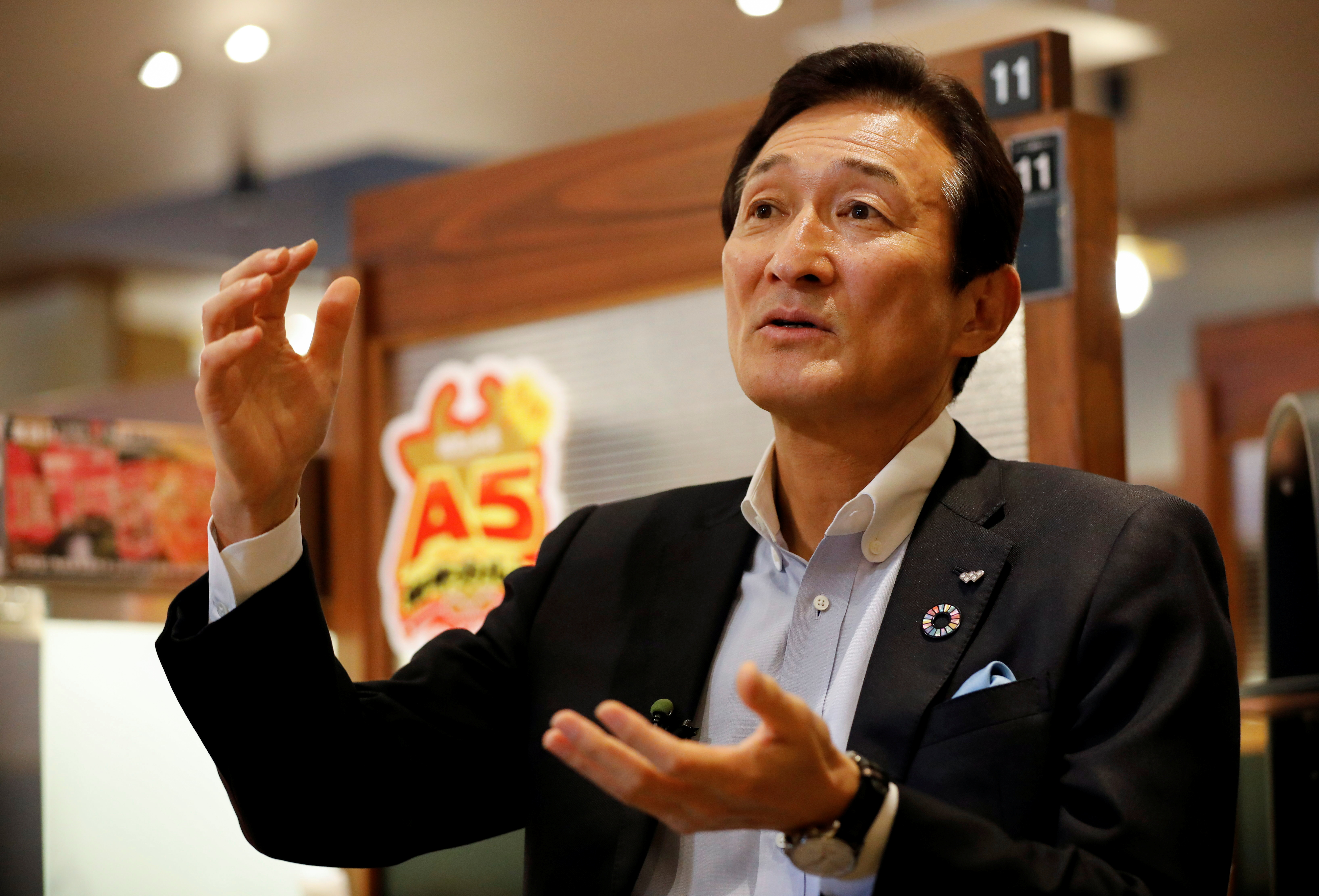 Miki Watanabe, Chairman and CEO of Watami Co. speaks during an interview with Reuters at the company's yakiniku barbecue restaurant named 'Yakiniku no Watami', in Tokyo, Japan September 15, 2021. Picture taken September 15, 2021.  REUTERS/Issei Kato