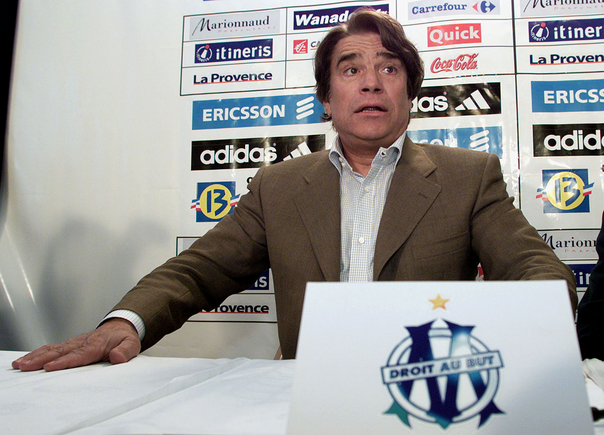 Bernard Tapie, the former chairman of the French soccer team Olympique de Marseille, answers questions during a press conference in Marseille, April 9, 2001. REUTERS/Jean-Paul Pelissier/File Photo
