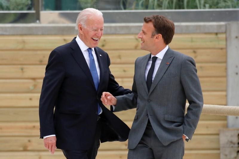 U.S.President Joe Biden and France's President Emmanuel Macron walk along the boardwalk during the G7 summit in Carbis Bay, Cornwall, Britain, June 11, 2021. REUTERS/Phil Noble/Pool