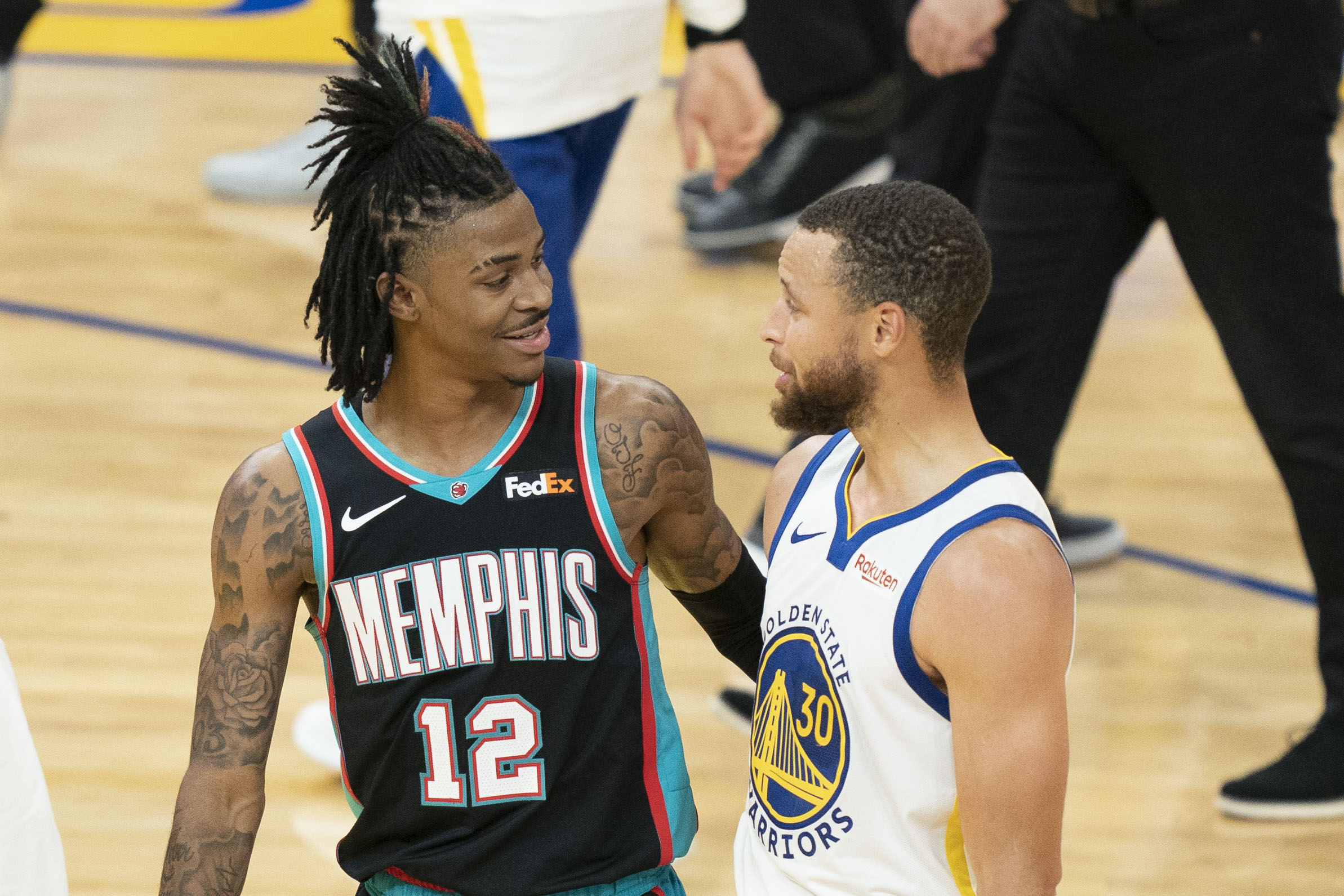 May 16, 2021; San Francisco, California, USA; Memphis Grizzlies guard Ja Morant (12) talks to Golden State Warriors guard Stephen Curry (30) after the game at Chase Center. Mandatory Credit: Kyle Terada-USA TODAY Sports