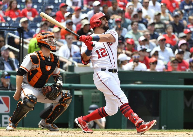Jun 13, 2021; Washington, District of Columbia, USA; Washington Nationals left fielder Kyle Schwarber (12) hits a three run home run against the San Francisco Giants during the second inning at Nationals Park. Mandatory Credit: Brad Mills-USA TODAY Sports
