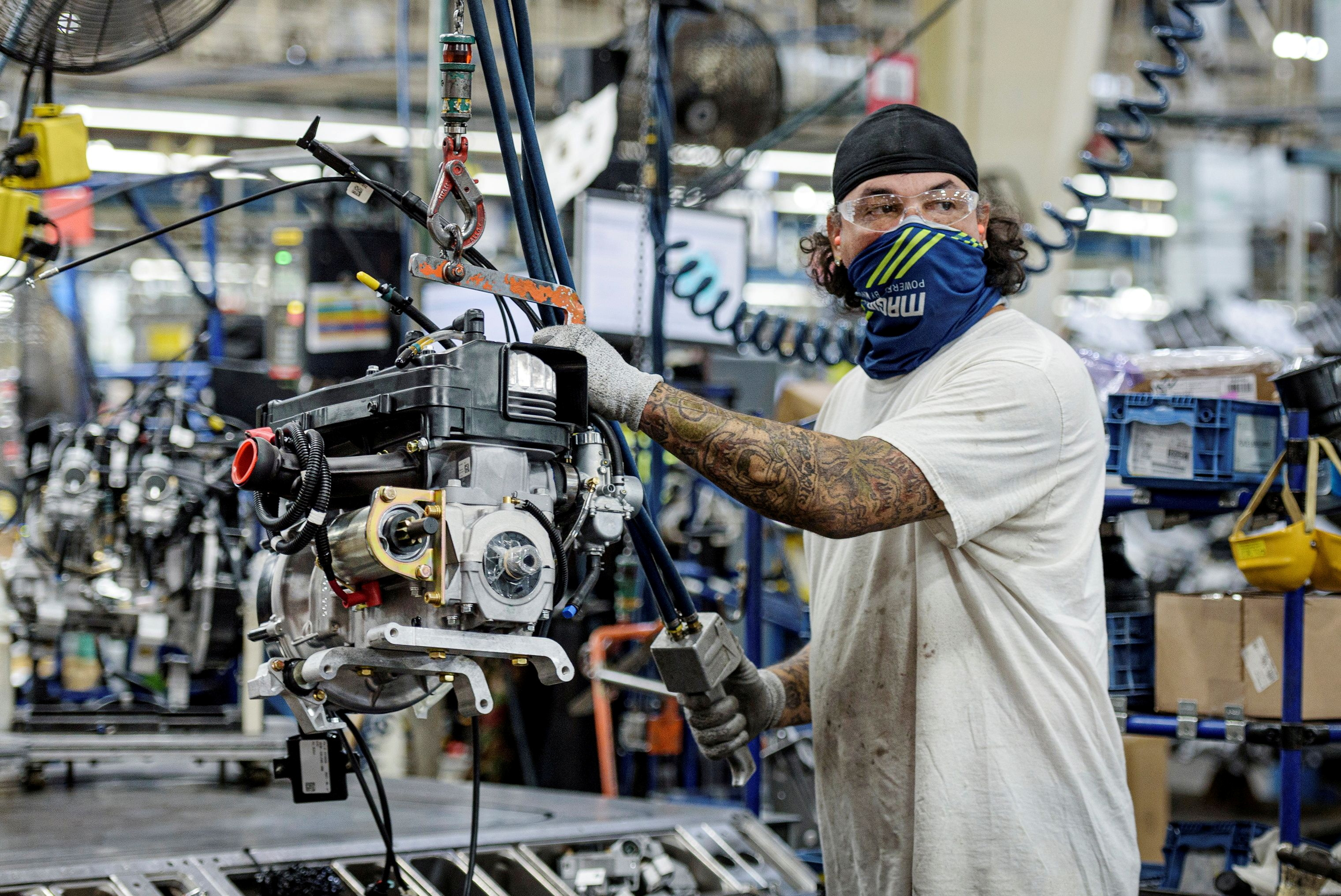 A person works on a Polaris snowmobile assembly line at their manufacturing and assembly plant in Roseau, Minnesota, U.S. June 7, 2021. Picture taken June 7, 2021.  REUTERS/Dan Koeck/File Photo