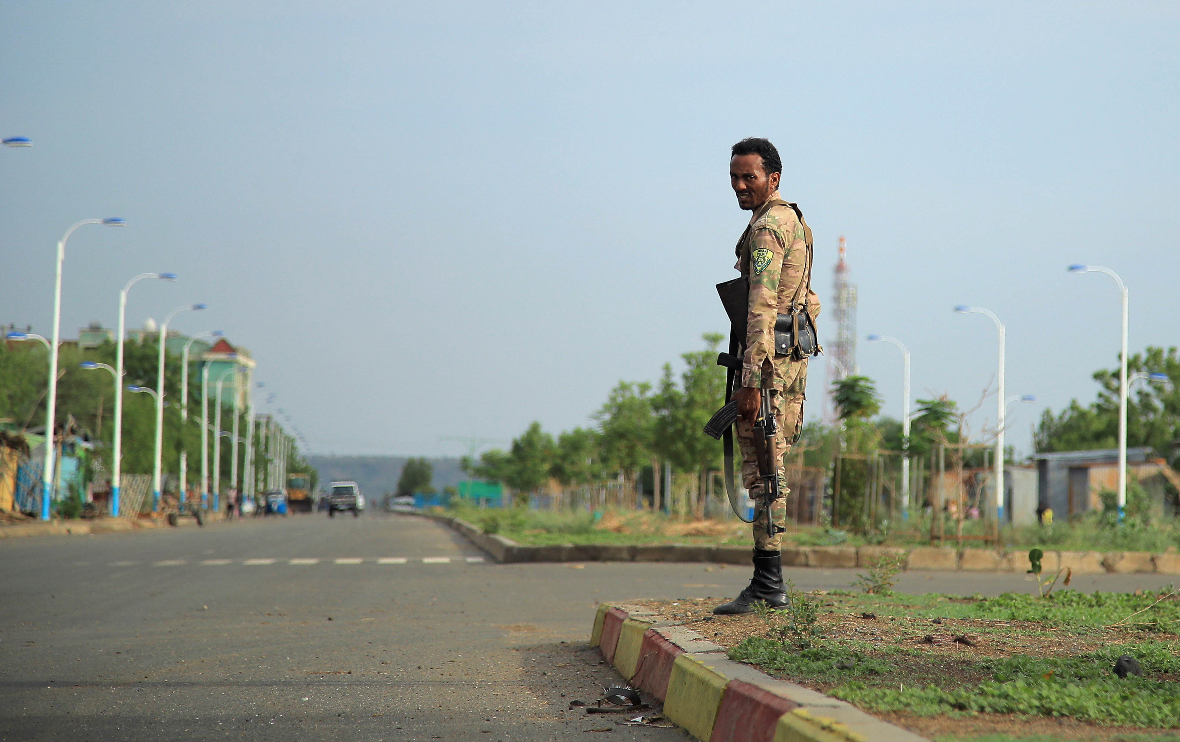 A member of Amhara Special Forces stands guard along a street in Humera town, Ethiopia July 1, 2021. REUTERS/Stringer