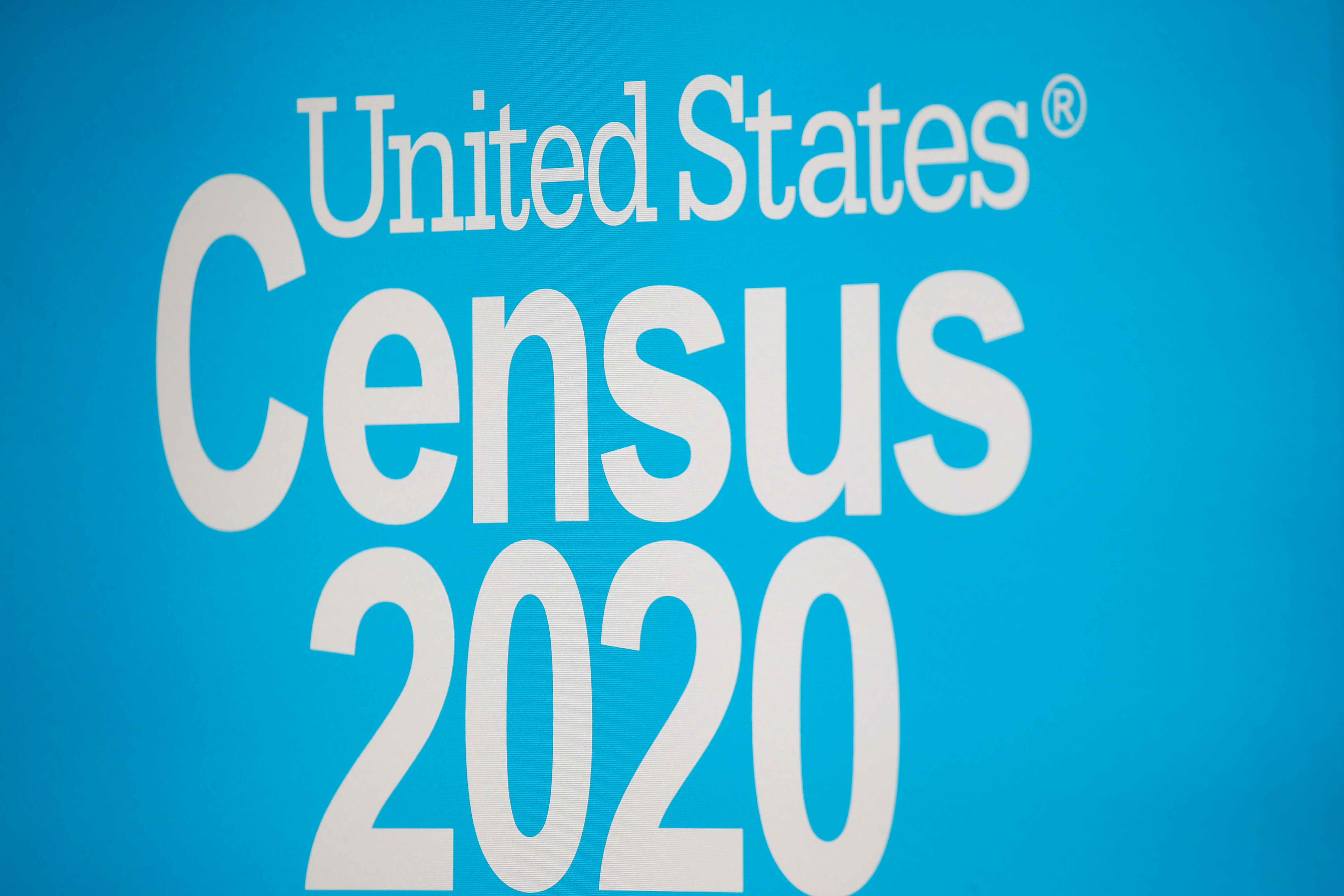 A sign is seen during a promotional event for the U.S. Census in Times Square in New York City, New York, U.S., September 23, 2020. REUTERS/Brendan McDermid/File Photo