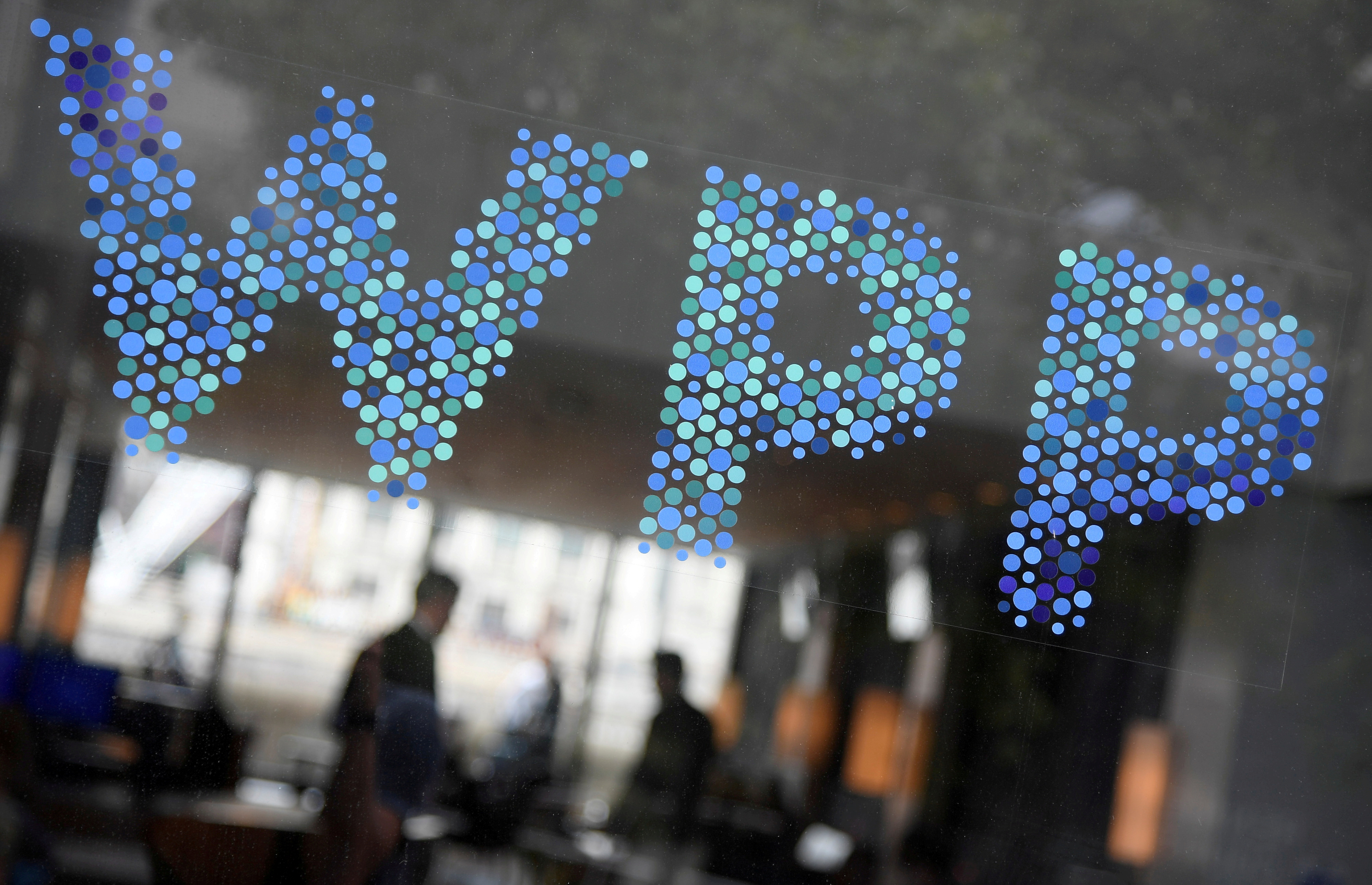 Branding signage for WPP, the largest global advertising and public relations agency at their offices in London, Britain, July 17, 2019. REUTERS/Toby Melville/File Photo