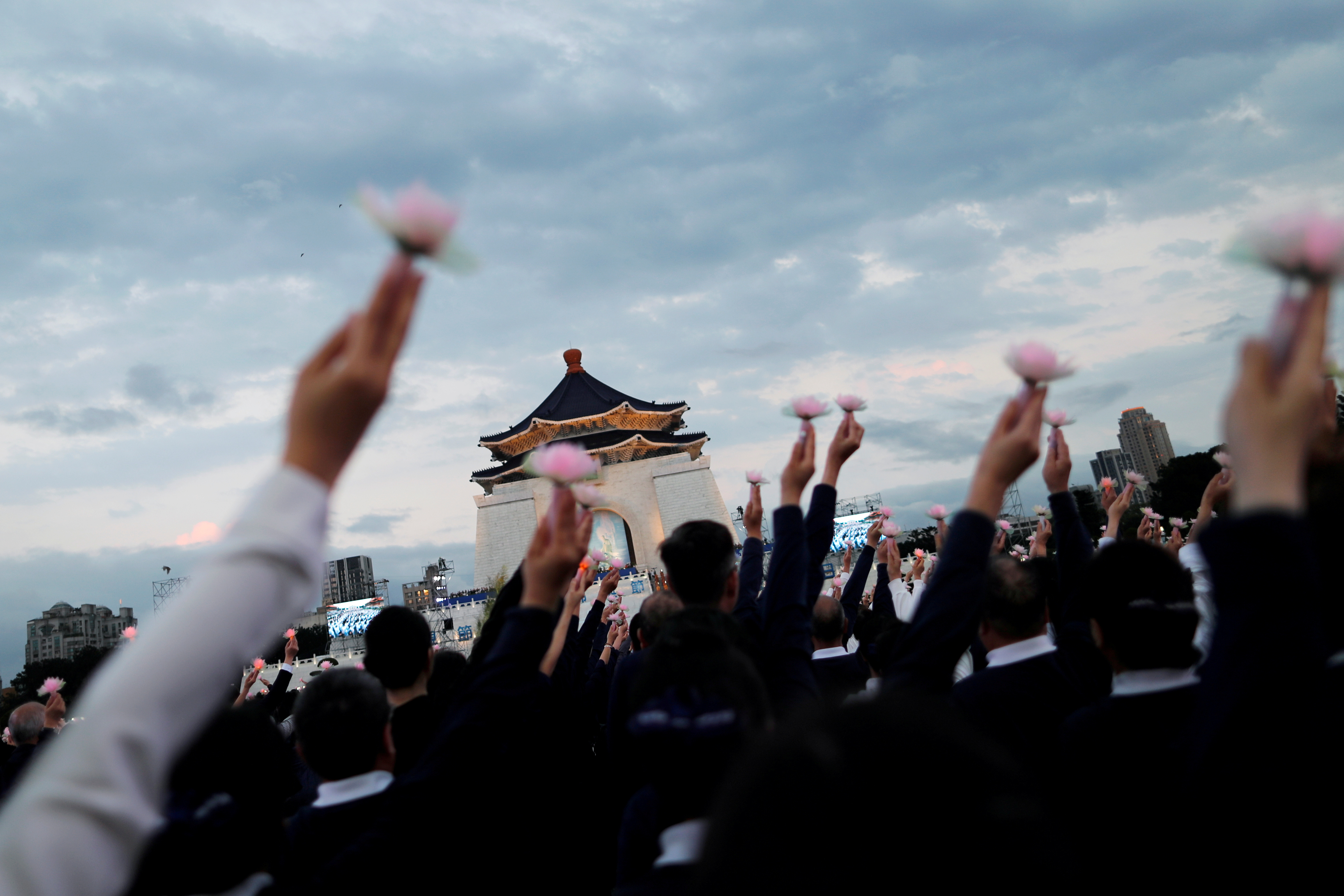 Members of the Buddhist Tzu Chi Foundation pray during a ceremony to commemorate the birth of Buddha, at the Liberty Square in Taipei, Taiwan May 12, 2019. REUTERS/Tyrone Siu TPX IMAGES OF THE DAY
