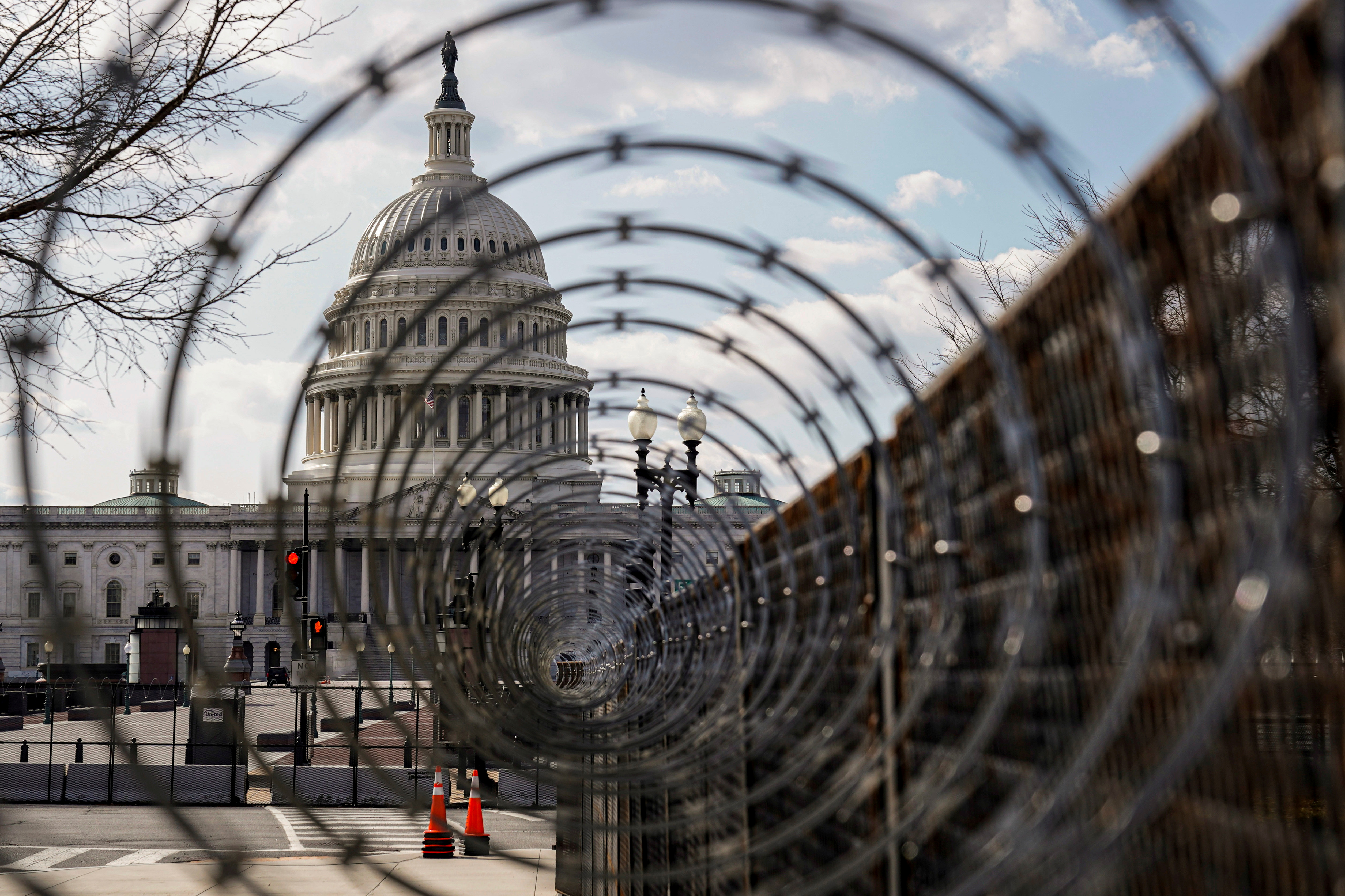 The U.S. Capitol is seen through razor wire after police warned that a militia group might try to attack the U.S. Capitol in Washington, U.S., March 4, 2021. REUTERS/Joshua Roberts/File Photo