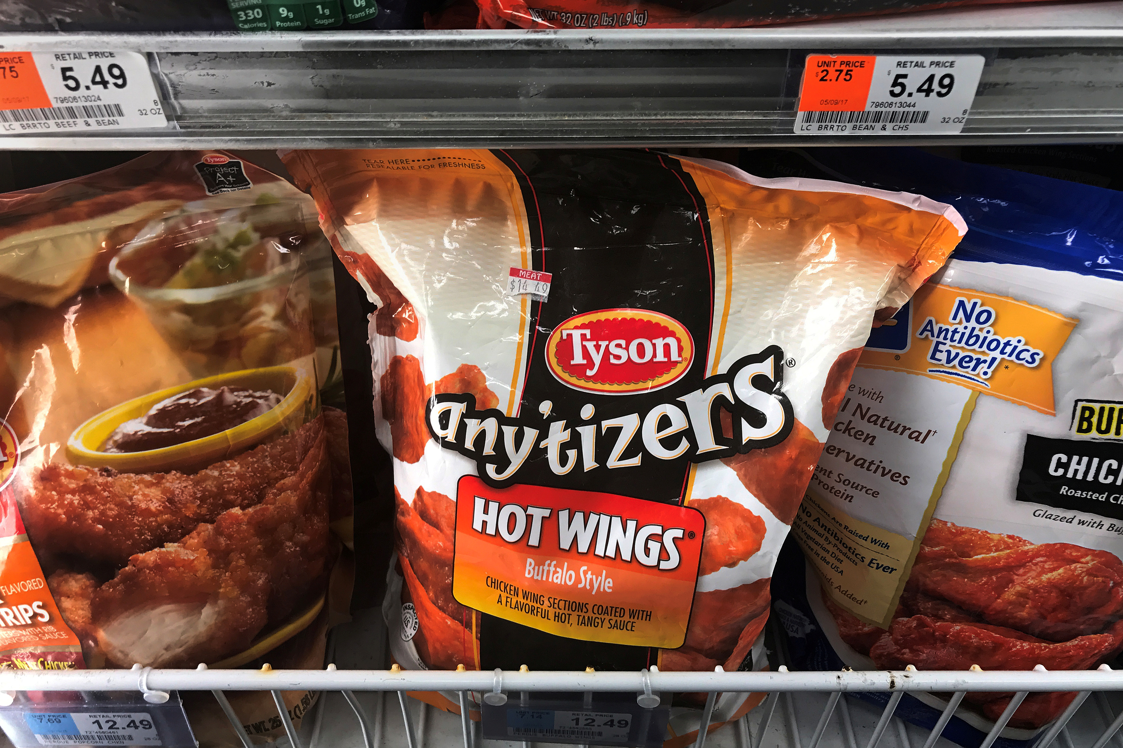 Tyson Foods brand frozen chicken wings are pictured in a grocery store freezer in the Manhattan borough of New York City, U.S. May 11, 2017.   REUTERS/Carlo Allegri/File Photo