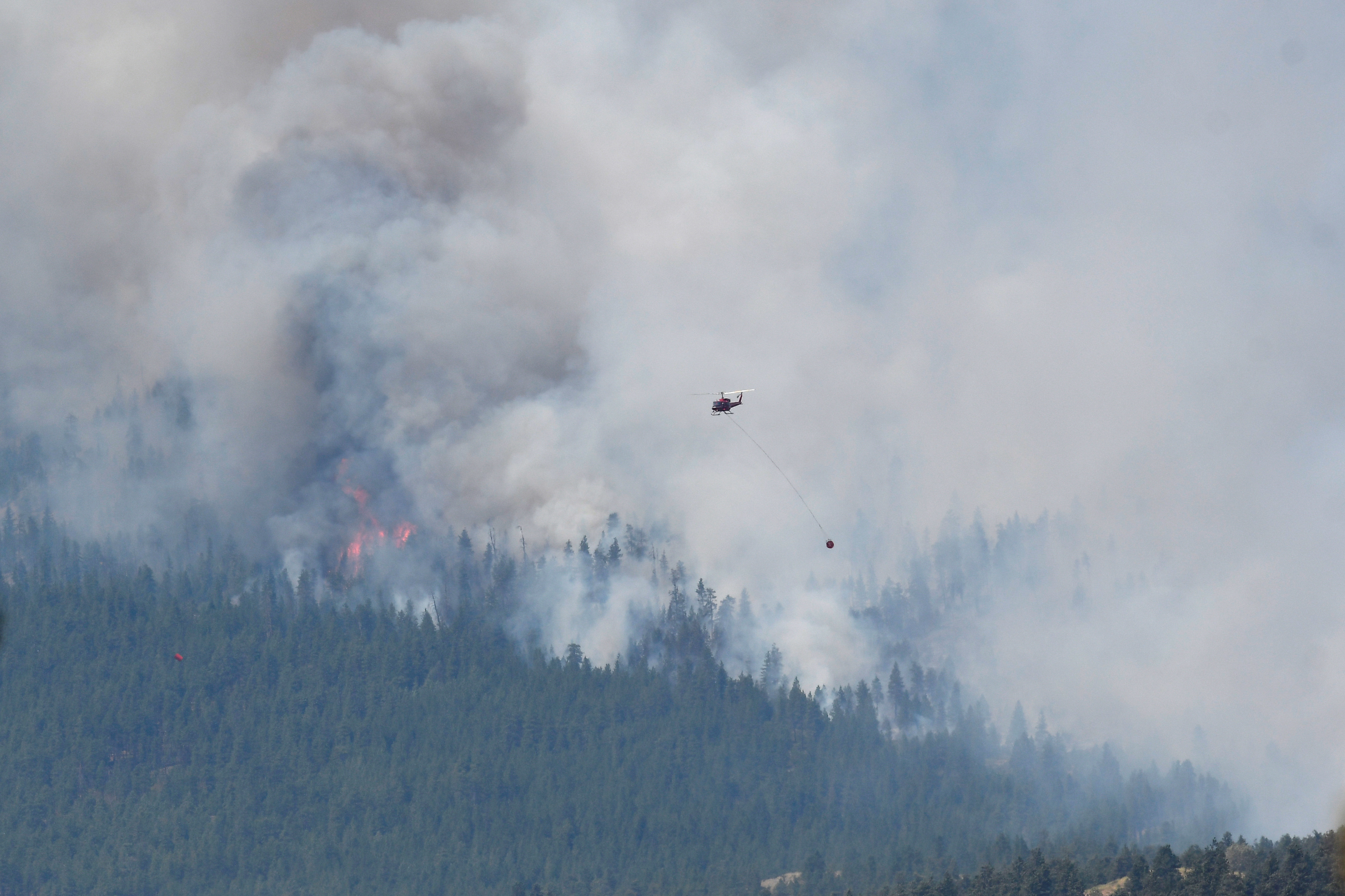A wildfire burns outside of the town of Lytton, where it raged through and forced everyone to evacuate, in British Columbia, Canada, July 1, 2021.  REUTERS/Jennifer Gauthier