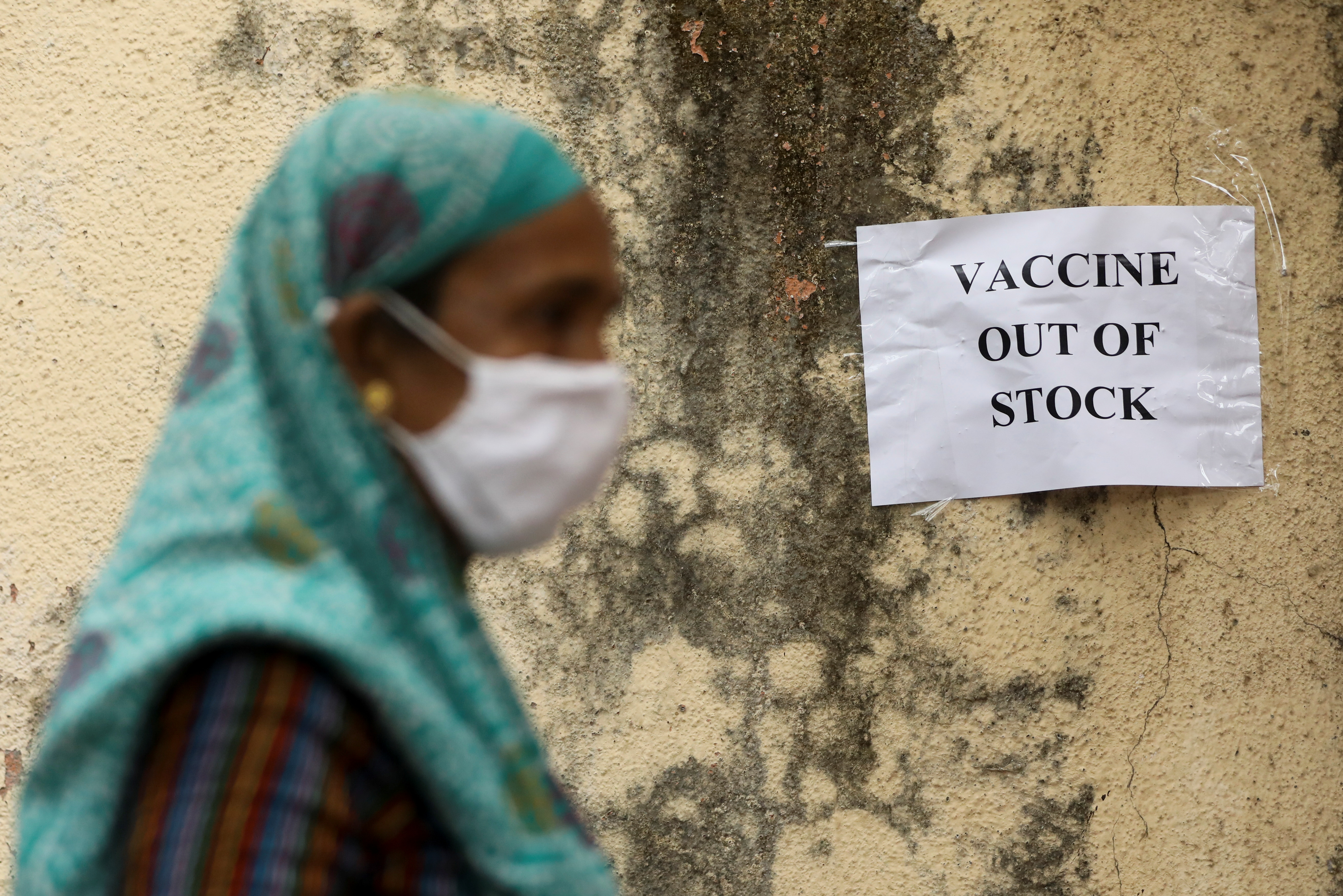 A notice about the shortage of coronavirus disease (COVID-19) vaccine supplies is seen at a vaccination centre, in Mumbai, India, April 8, 2021. REUTERS/Francis Mascarenhas/File photo