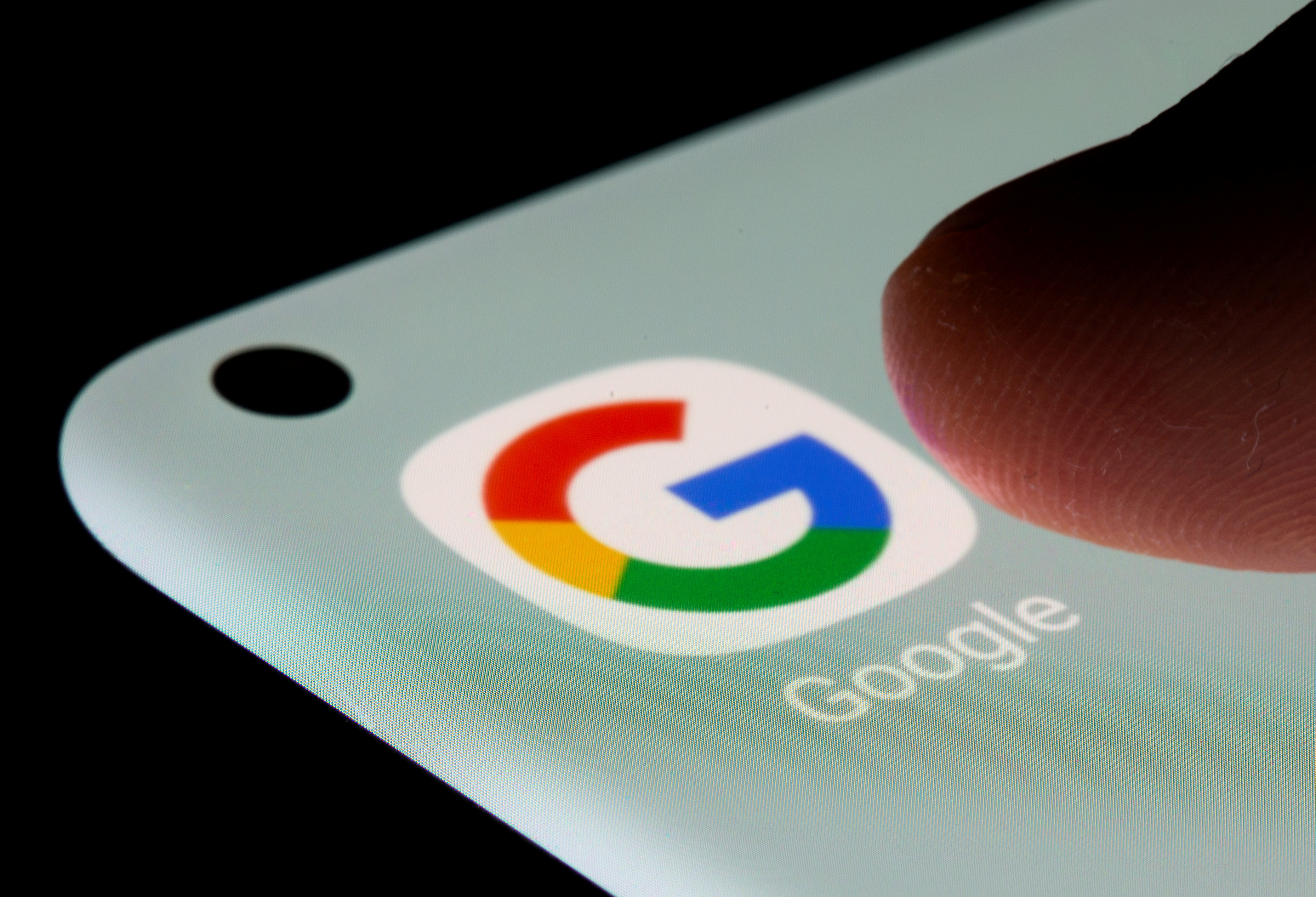 Google app is seen on a smartphone in this illustration taken, July 13, 2021. REUTERS/Dado Ruvic/Illustration/File Photo