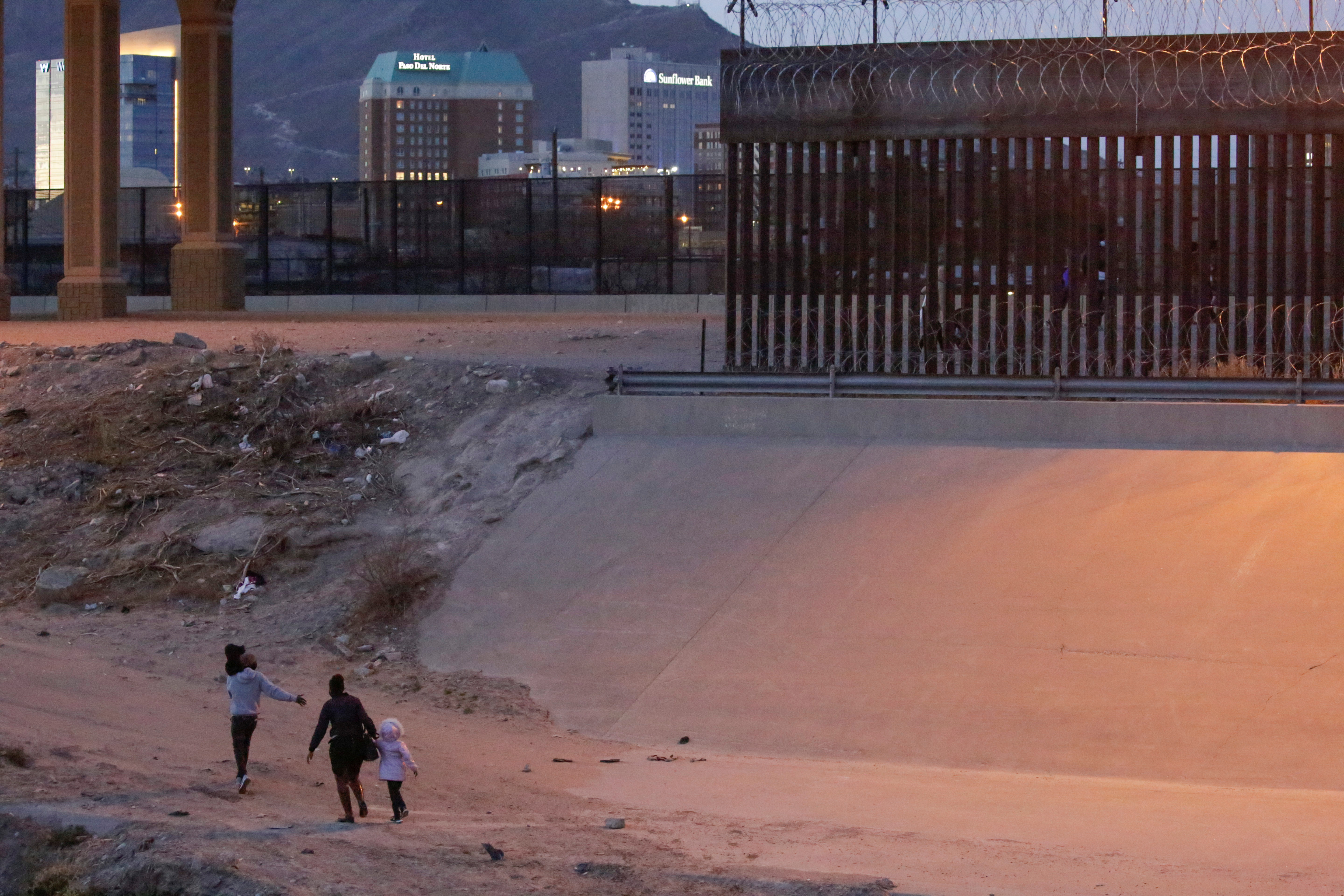 Migrants are seen after crossing the Rio Bravo river to turn themselves in to U.S. Border Patrol agents to request for asylum in El Paso, Texas, U.S., as seen from Ciudad Juarez, Mexico March 4, 2021. REUTERS/Jose Luis Gonzalez