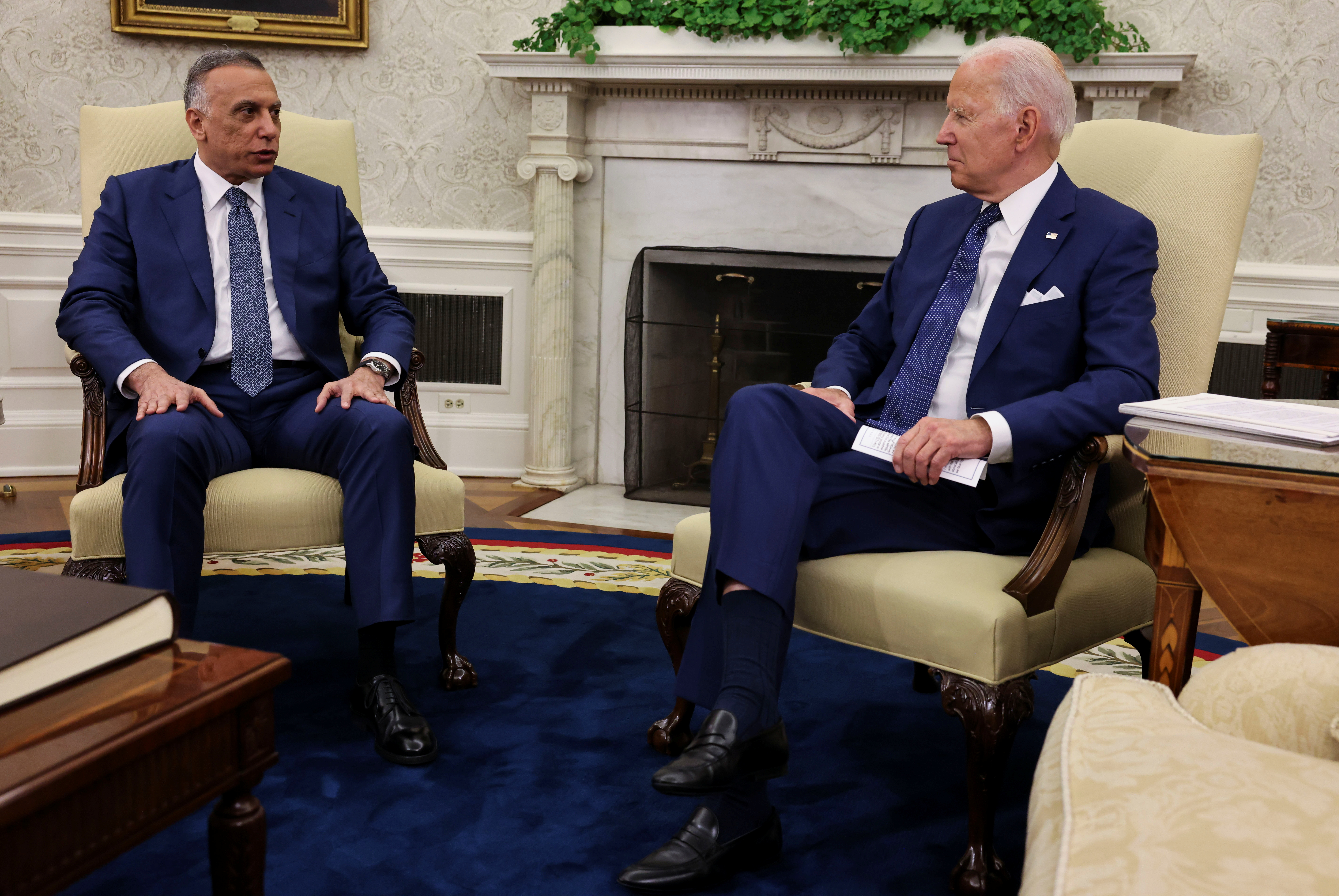 U.S. President Joe Biden listens to Iraq's Prime Minister Mustafa Al-Kadhimi during a bilateral meeting in the Oval Office at the White House in Washington, U.S., July 26, 2021. REUTERS/Evelyn Hockstein