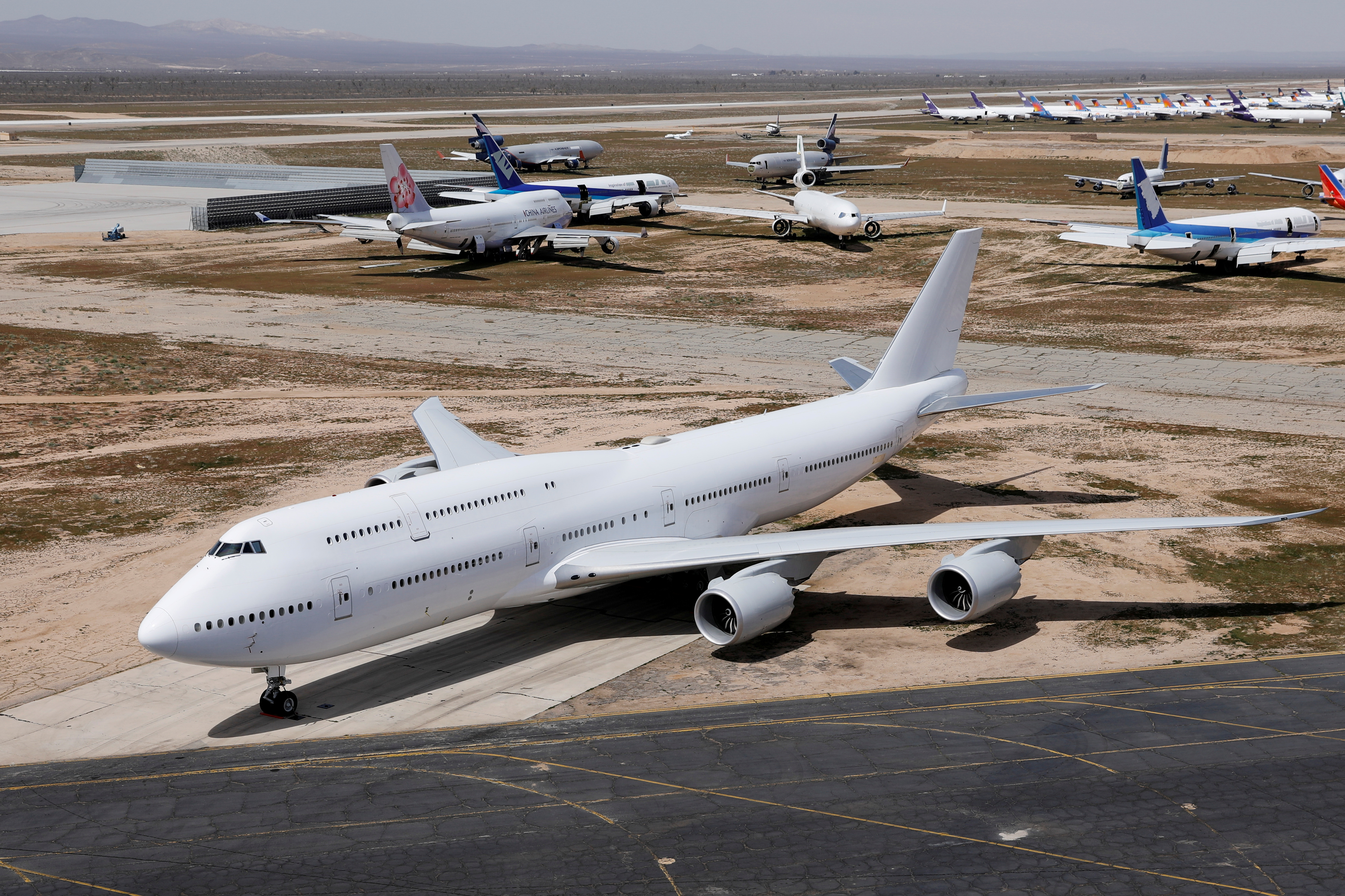 A Boeing 747-8, one of two that had originally been ordered by a now-bankrupt Russian airline and later earmarked for an Air Force One replacement project, is seen parked at Victorville Airport in Victorville, California, U.S., March 26, 2019.  REUTERS/Mike Blake/File Photo