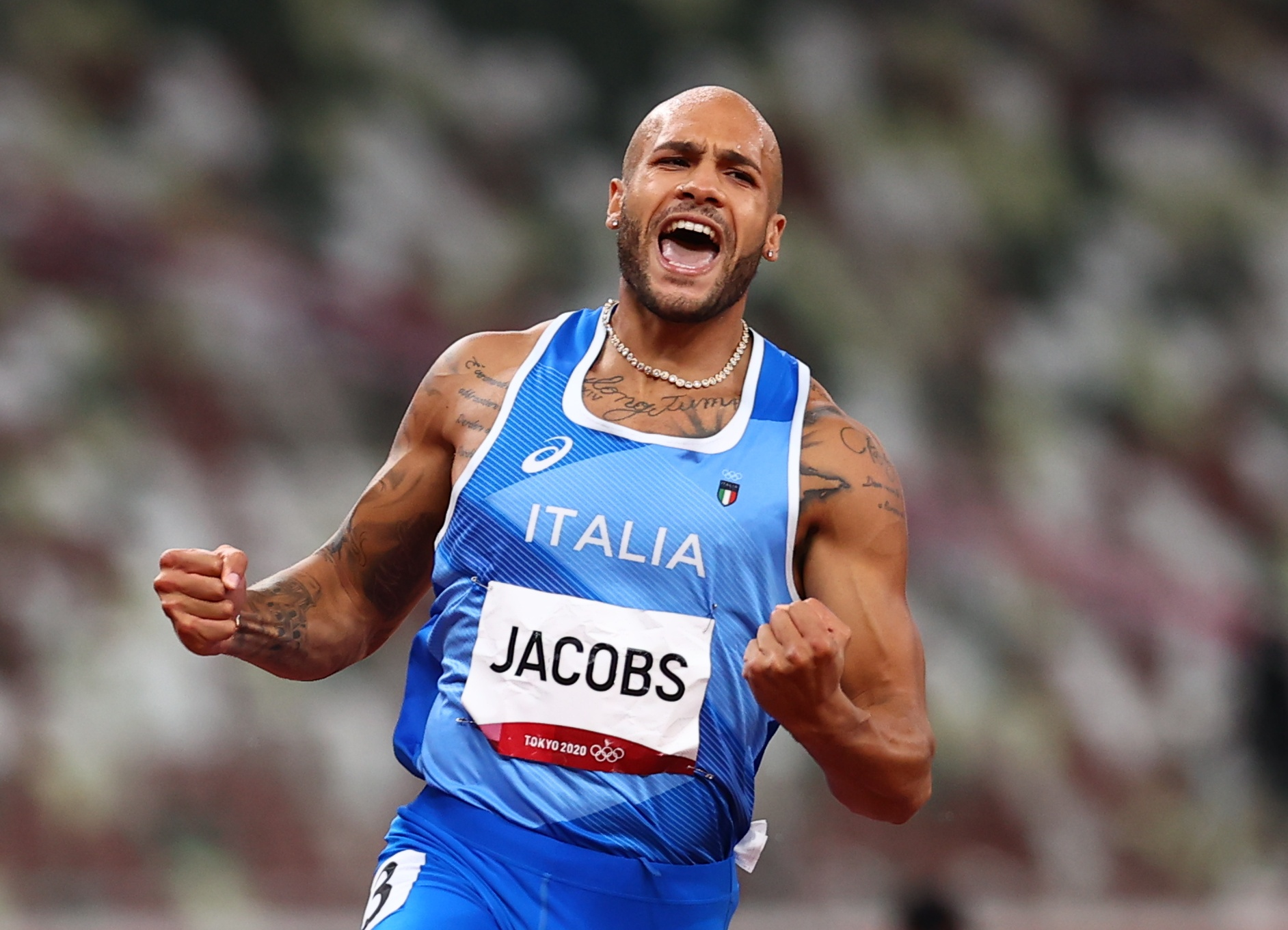 Tokyo 2020 Olympics - Athletics - Men's 100m - Final - OLS - Olympic Stadium, Tokyo, Japan - August 1, 2021. Lamont Marcell Jacobs of Italy celebrates after winning gold REUTERS/Andrew Boyers