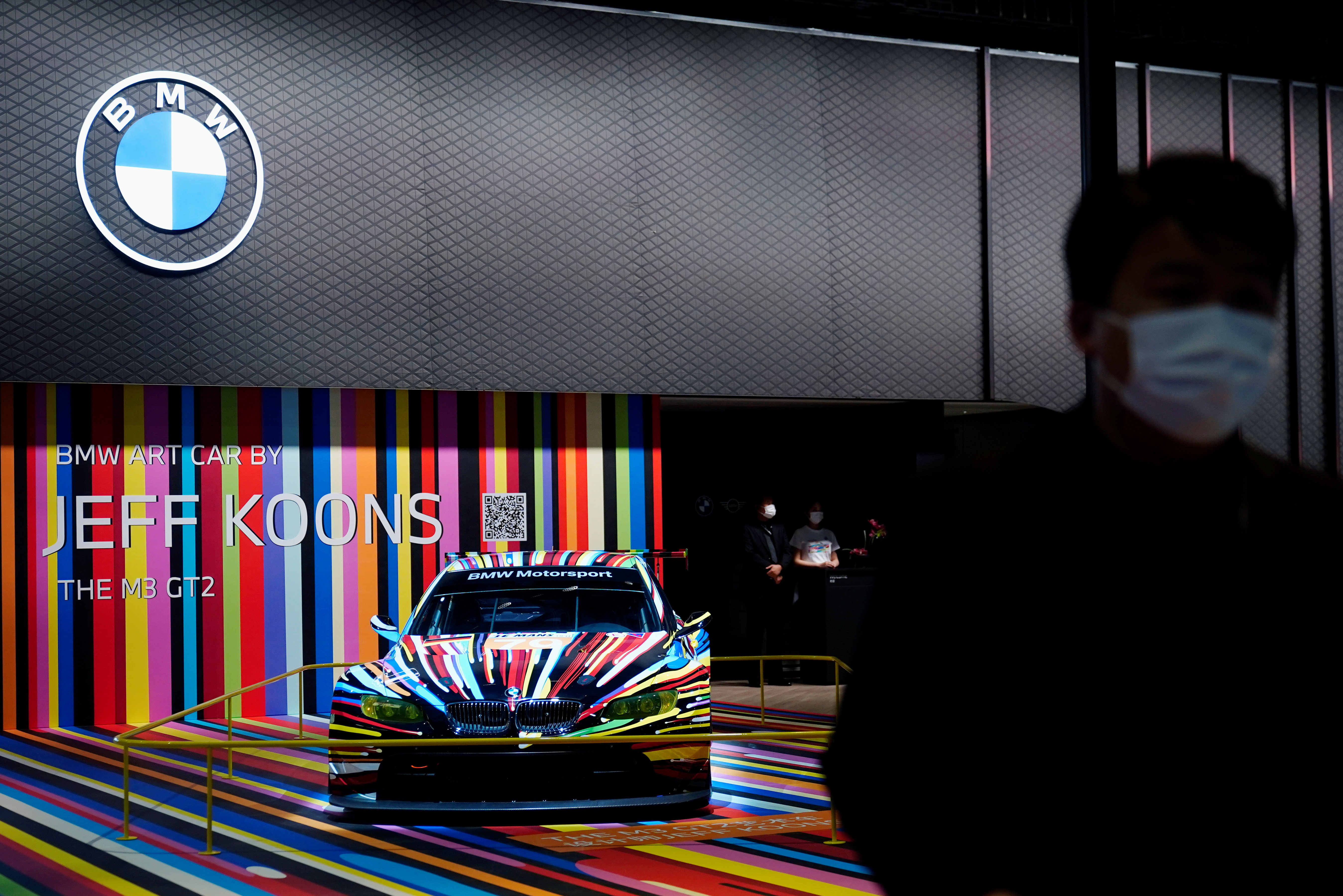 A staff member stands near a BMW M3 GT2 vehicle displayed at the BMW booth during a media day for the Auto Shanghai show in Shanghai, China April 19, 2021. REUTERS/Aly Song
