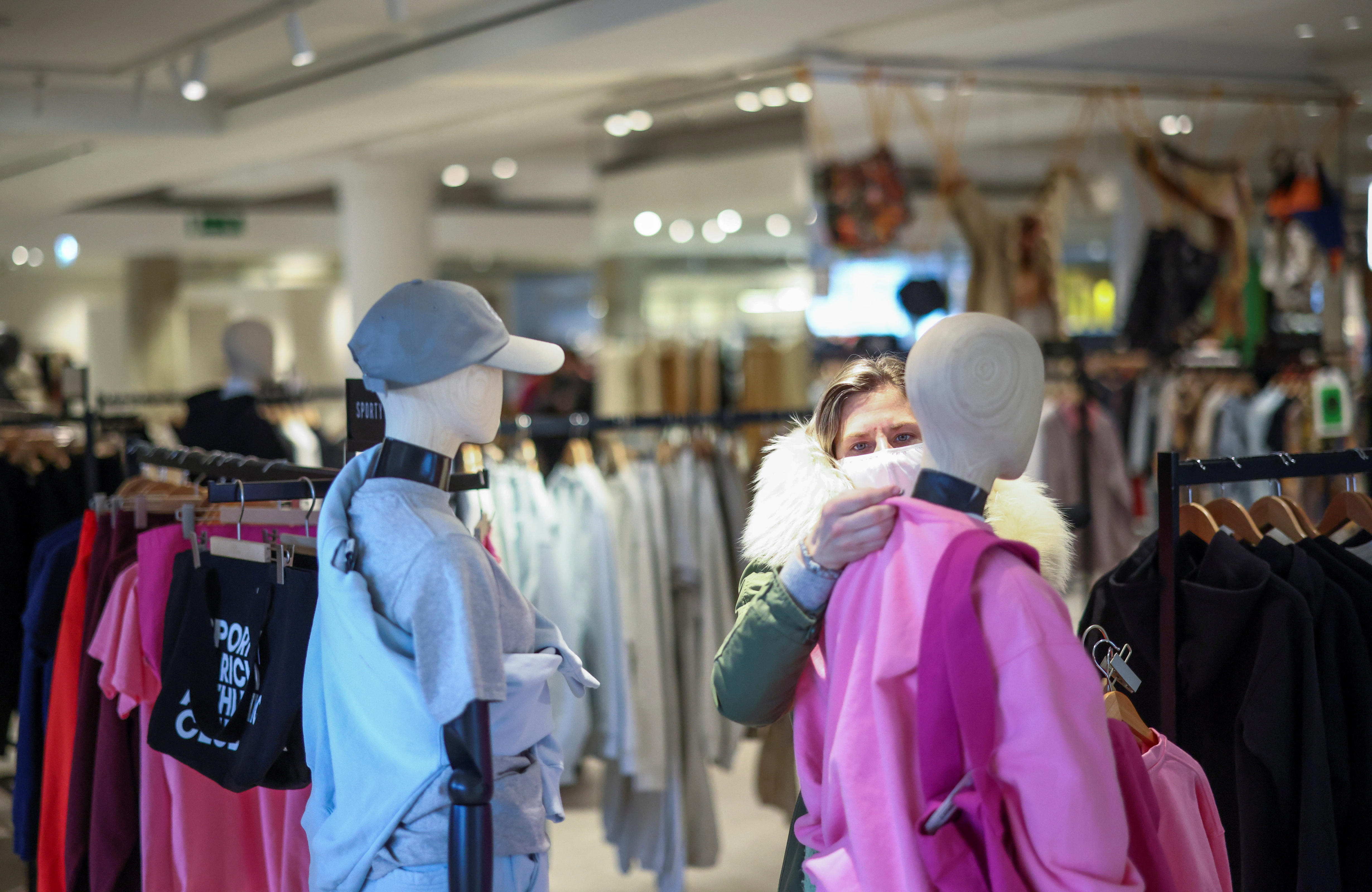 A woman shops in the Selfridges department store on Oxford street, as the coronavirus disease (COVID-19) restrictions ease, in London, Britain April 12, 2021. REUTERS/Henry Nicholls