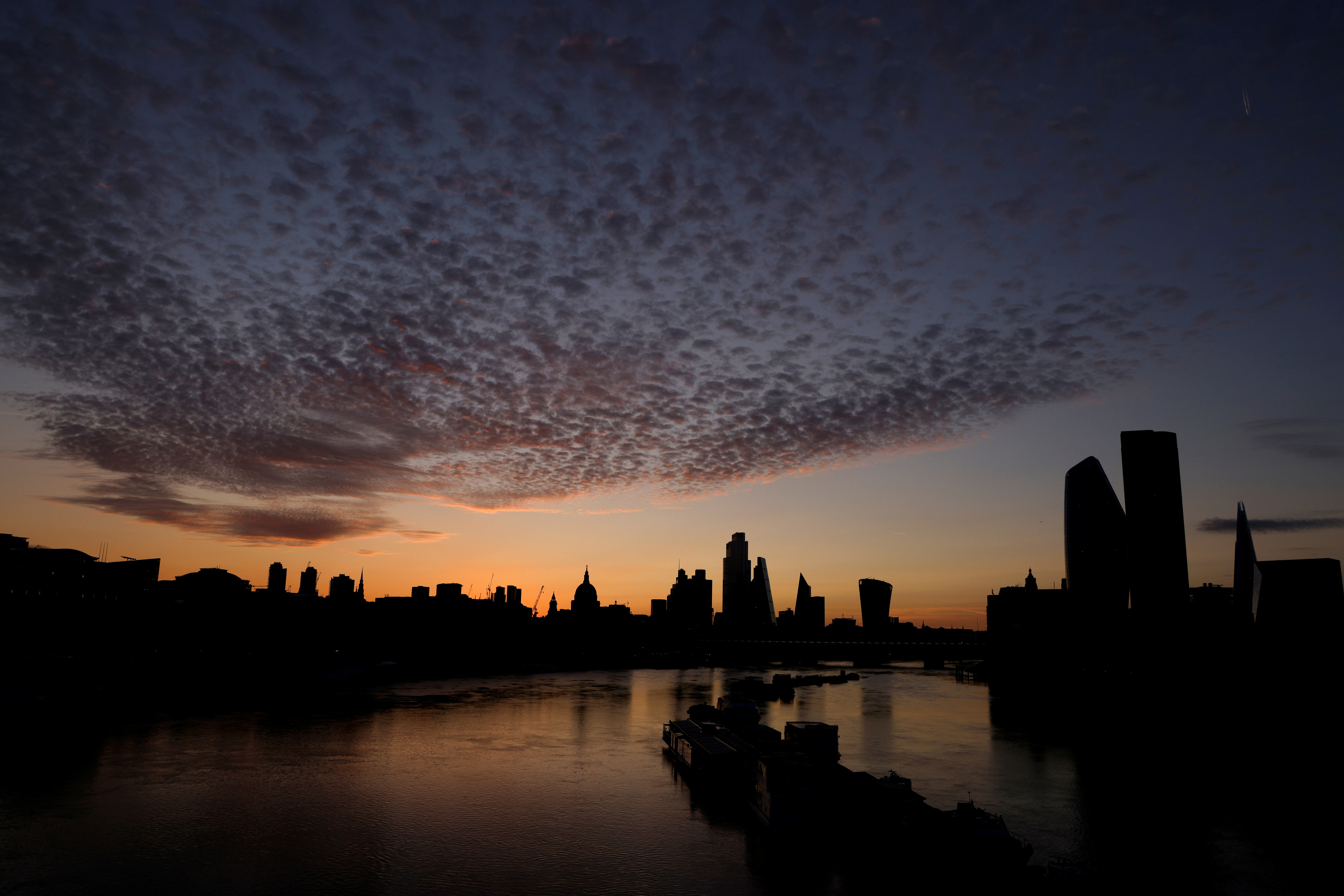 The skyline of St Paul's Cathedral and the City of London is seen before dawn in London, Britain, August 2, 2020. REUTERS/John Sibley
