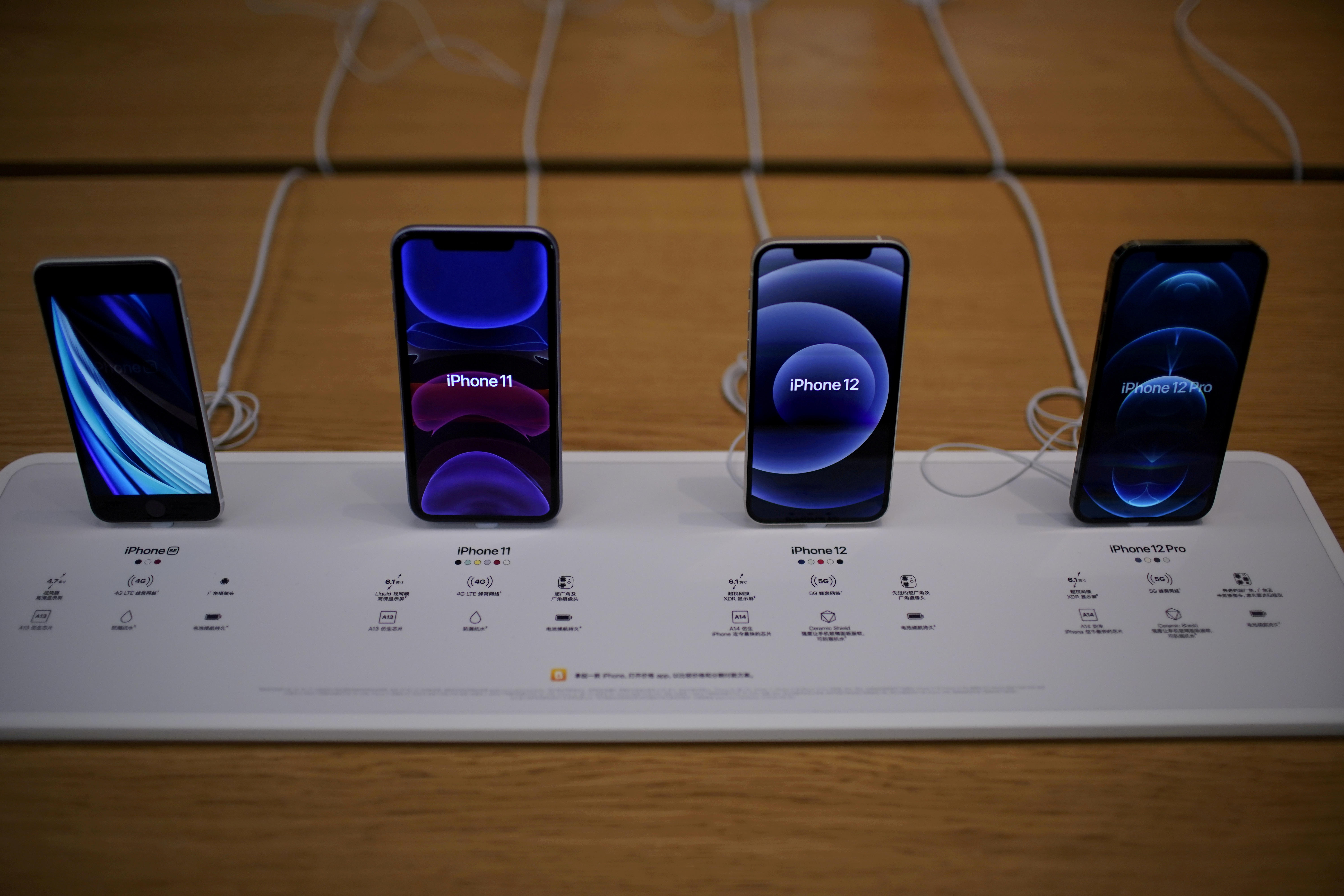 Apple's 5G iPhone 12 and iPhone 11 are seen at an Apple Store in Shanghai, China October 23, 2020. REUTERS/Aly Song/File Photo