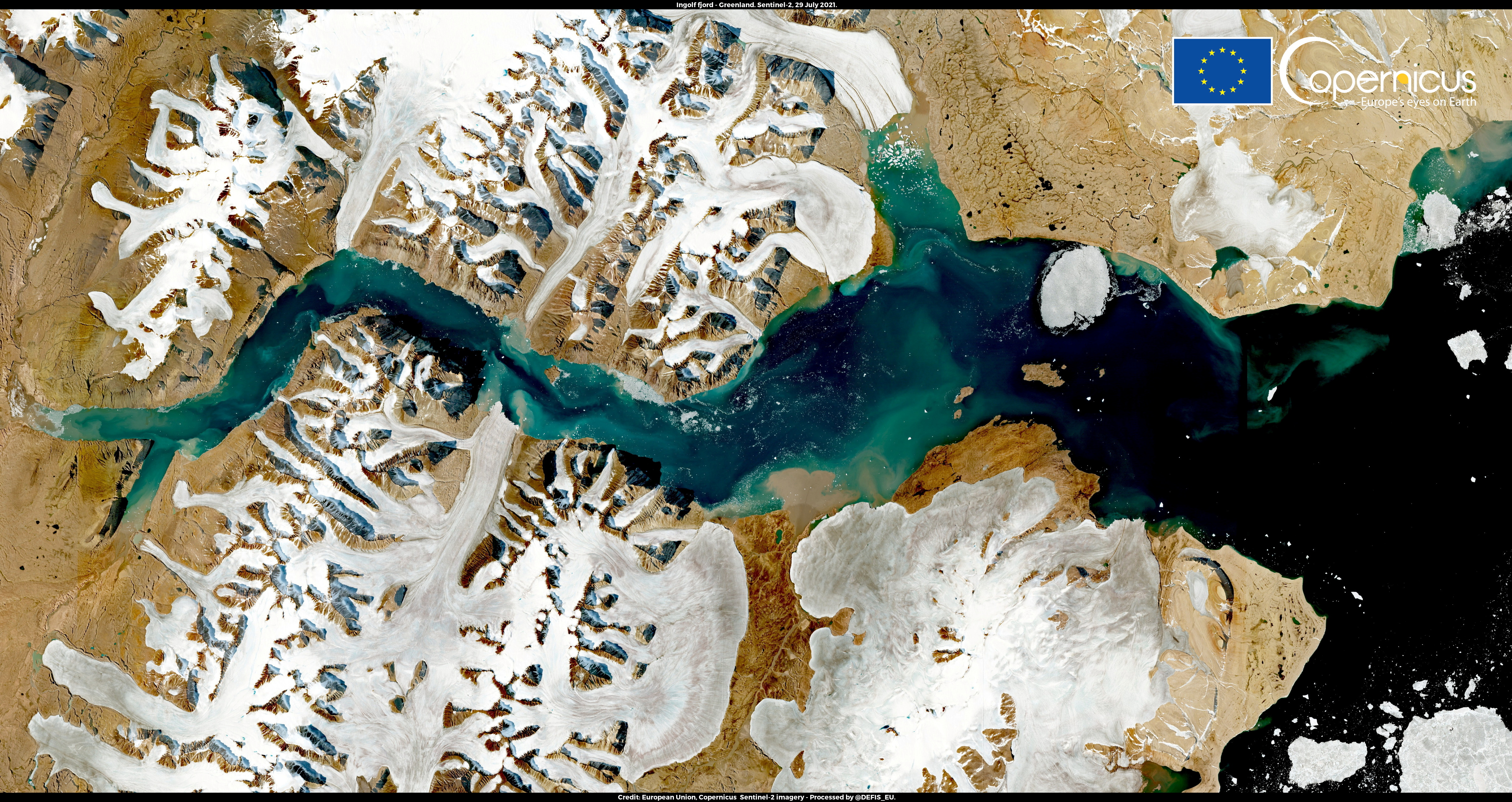 A satellite image shows Ingolf Fjord, Greenland July 29, 2021. Picture taken July 29, 2021. European Union, Copernicus Sentinel-2 imagery - Processed by @DEFIS_EU/Handout via REUTERS