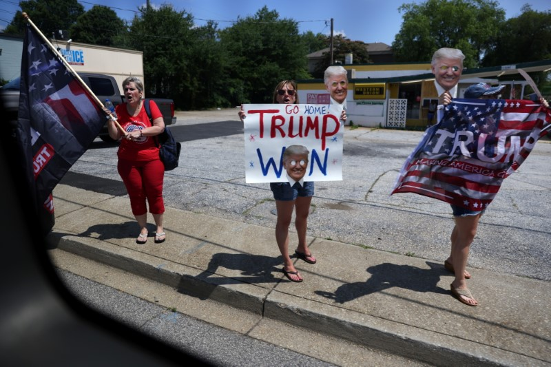 Supporters of former U.S. President Donald Trump protest the motorcade of U.S. Vice President Kamala Harris as it drives by during a day trip to promote the coronavirus disease (COVID-19) vaccine in Greenville, South Carolina, U.S., June 14, 2021. REUTERS/Leah Millis