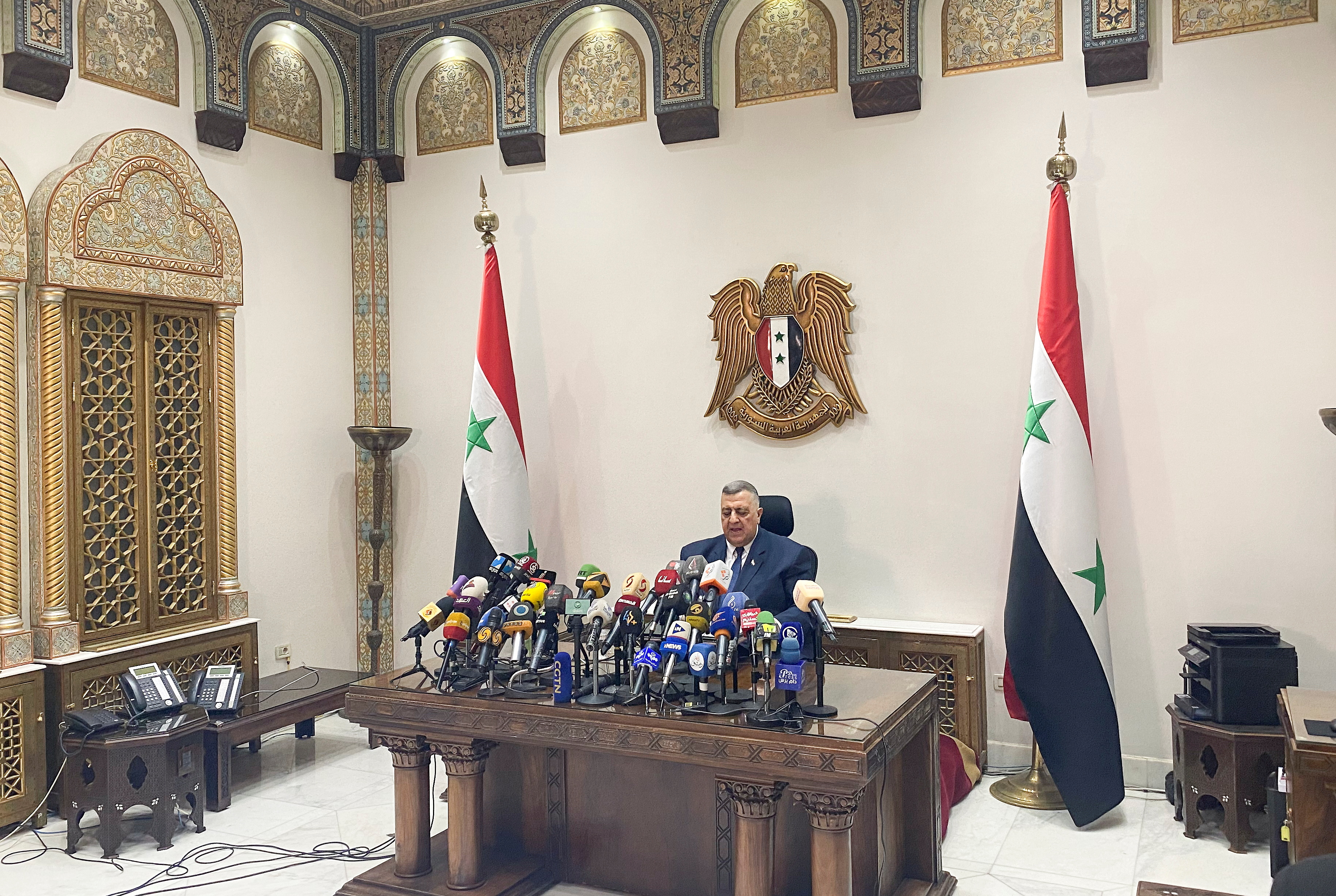 Parliament Speaker Hammouda Sabbagh announces the results of the Syrian presidential election at the Syrian parliament building in Damascus, Syria, May 27, 2021. REUTERS/Firas Makdesi