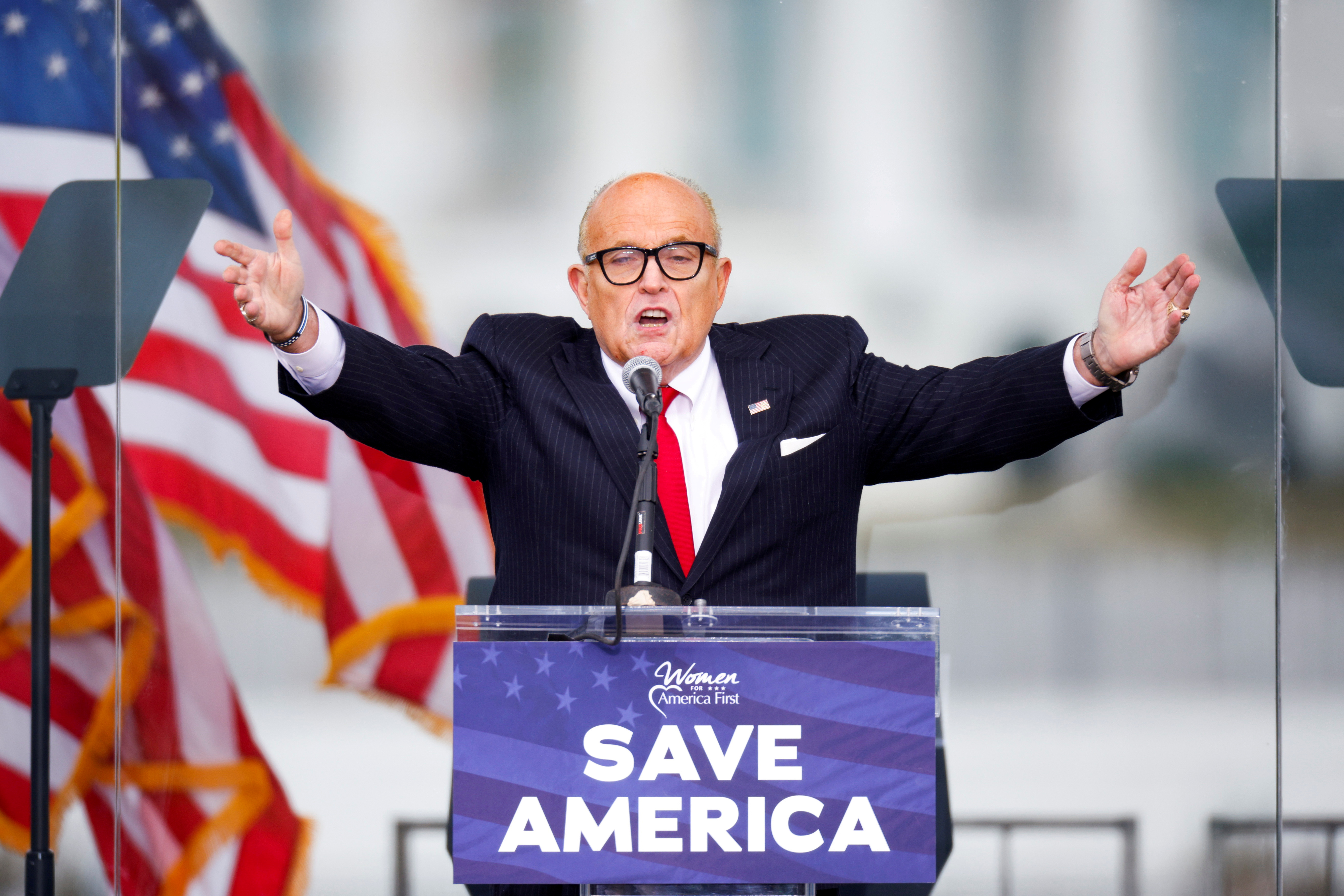 U.S. President Donald Trump's personal lawyer Rudy Giuliani gestures as he speaks as Trump supporters gather by the White House ahead of his speech to contest the certification by the U.S. Congress of the results of the 2020 U.S. presidential election in Washington, U.S, January 6, 2021. REUTERS/Jim Bourg
