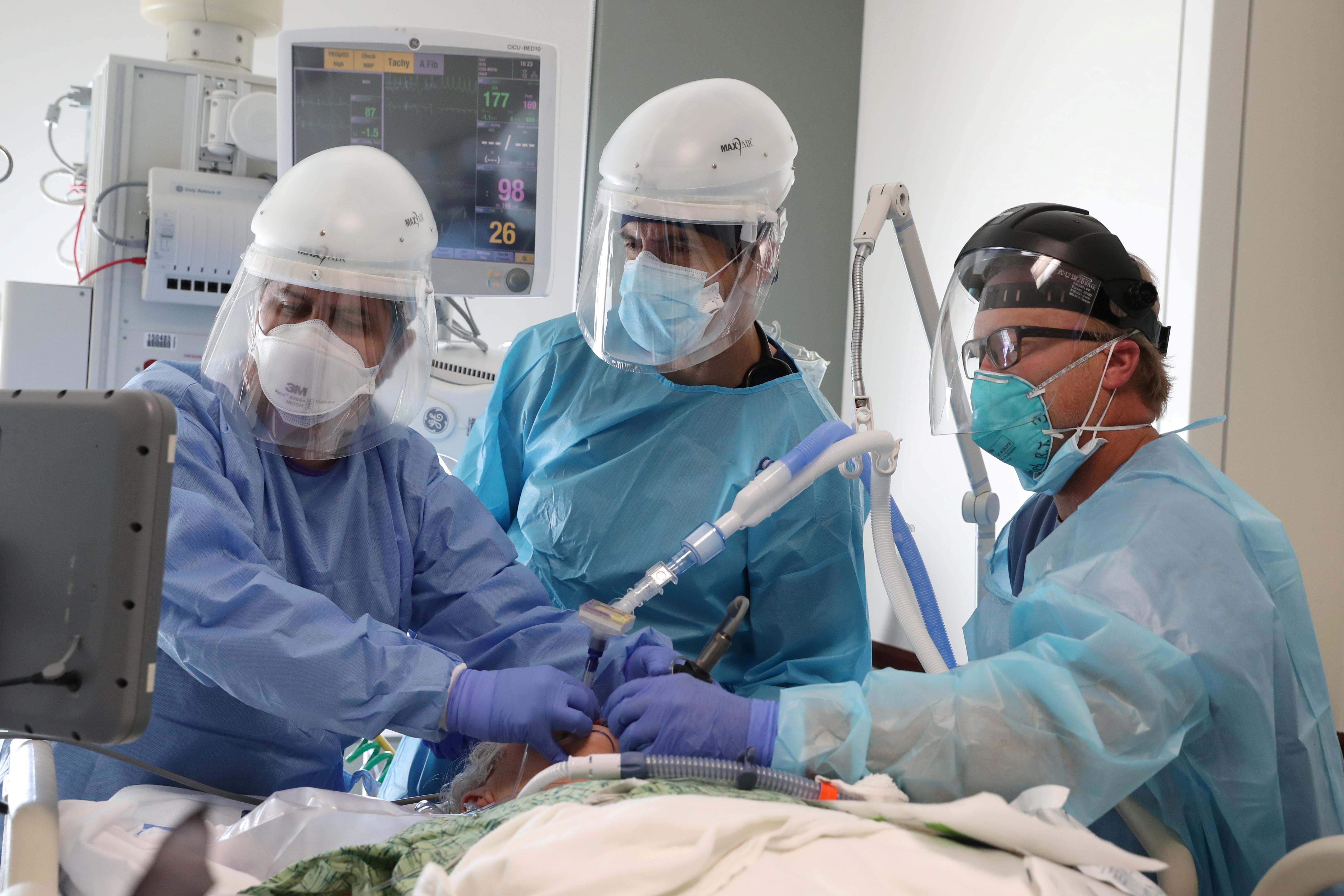 Dr. Dan Ponticiello, 43, and Dr. Gabriel Gomez, 40, intubate a coronavirus disease (COVID-19) patient in the COVID-19 ICU at Providence Mission Hospital in Mission Viejo, California, U.S., January 8, 2021. REUTERS/Lucy Nicholson/File Photo