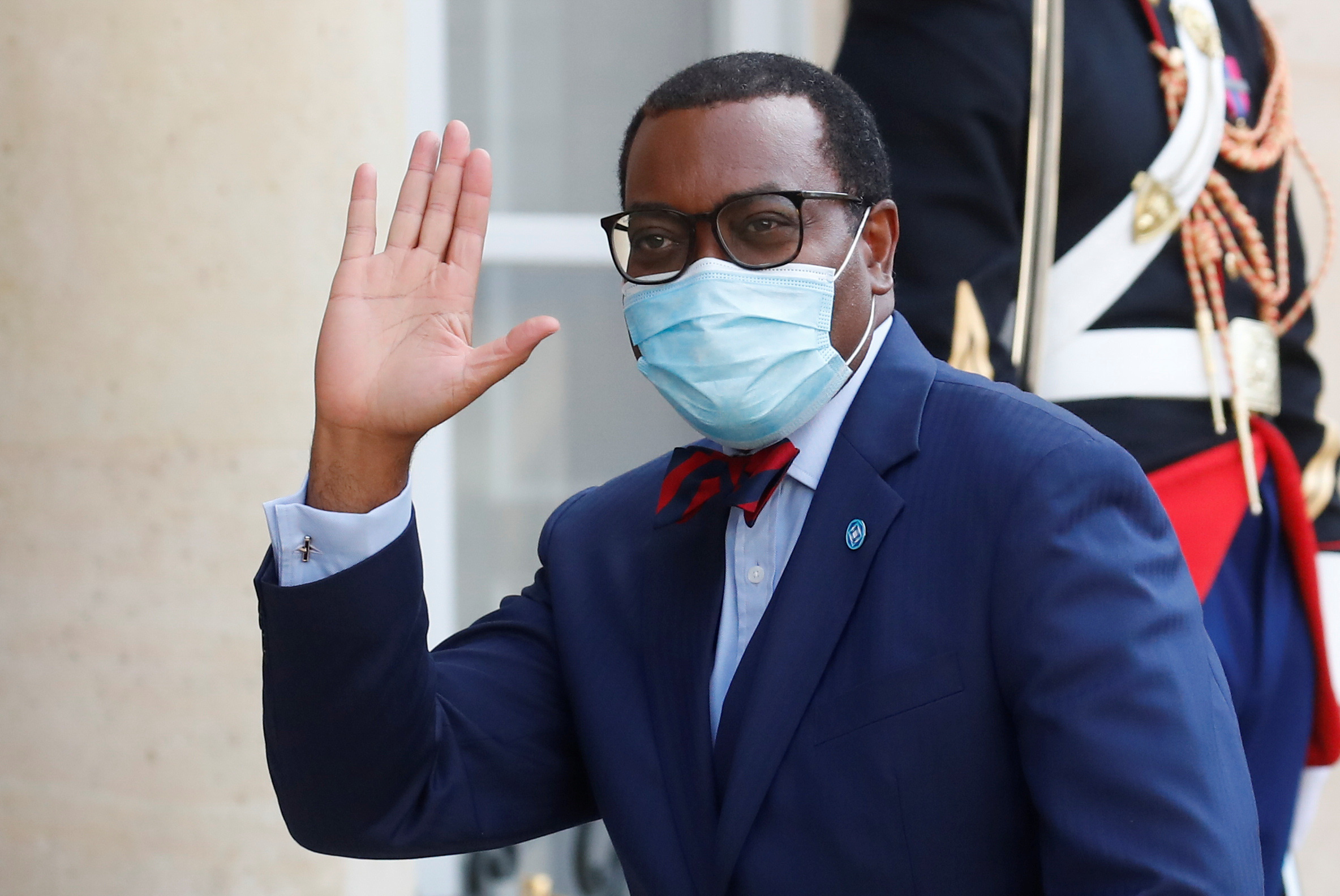 President of the African Development Bank, M. Akinwumi Adesina waves as he arrives for a dinner with French President Emmanuel Macron and leaders of African states and international organisations on the eve of a summit on aid for Africa, at Elysee Palace in Paris, France, May 17, 2021. REUTERS/Gonzalo Fuentes/File Photo