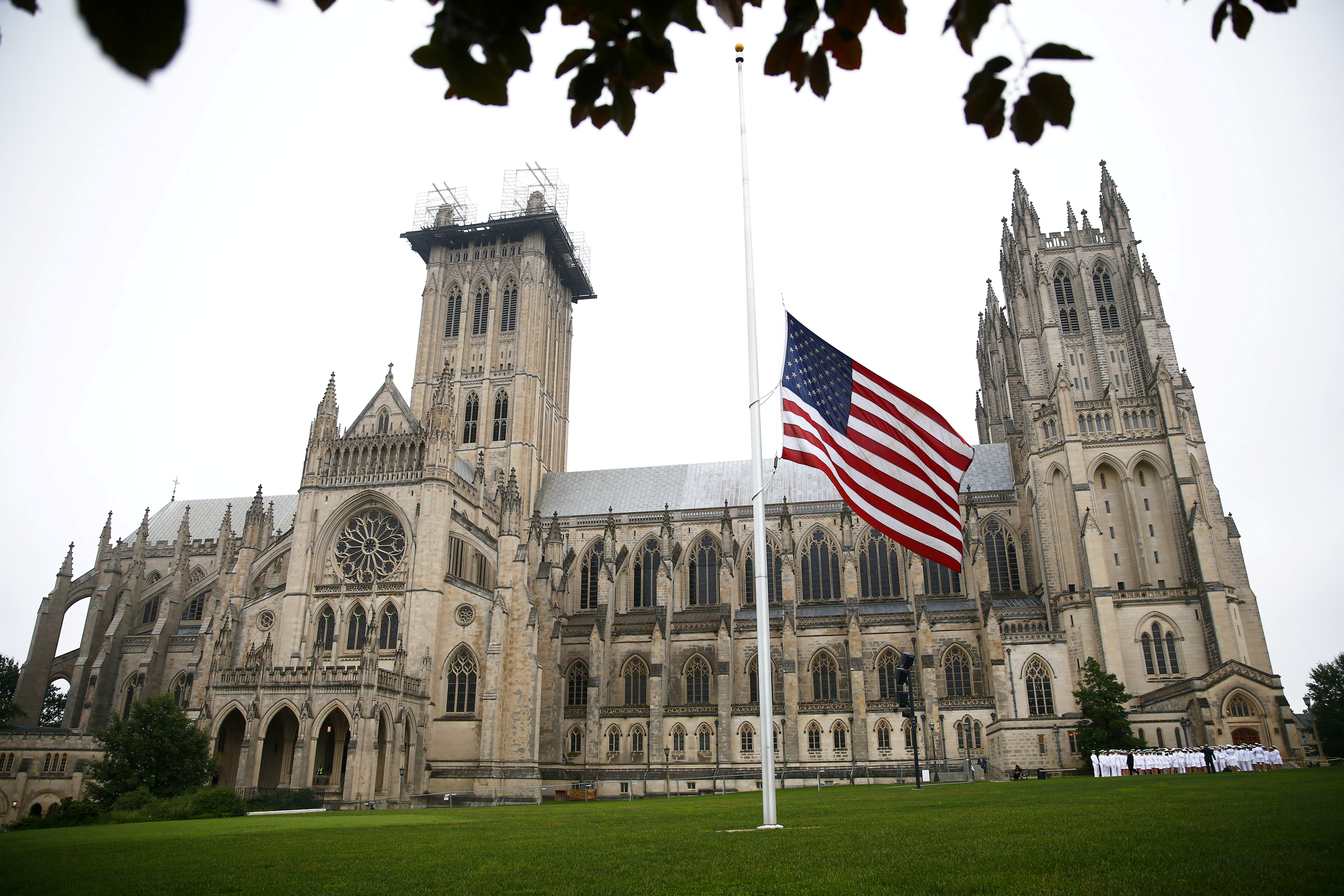 A flag flies at half staff in front of the Washington National Cathedral ahead of a ceremony for the late Senator John McCain in Washington, U.S. September 1, 2018. REUTERS/Eric Thayer