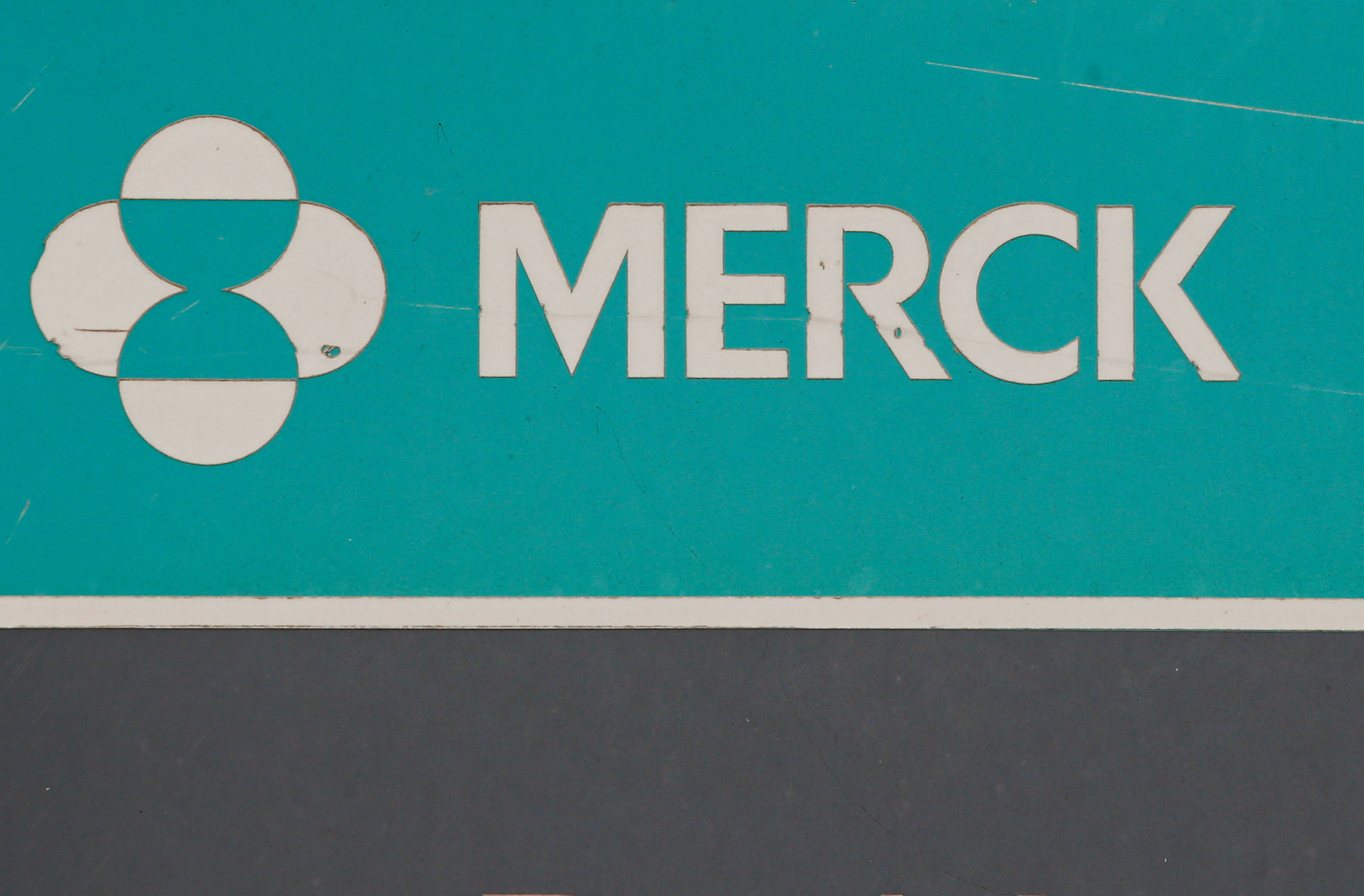 The Merck logo is seen on a sign at the Merck & Co campus in Rahway, New Jersey, U.S., July 12, 2018. REUTERS/Brendan McDermid/Files