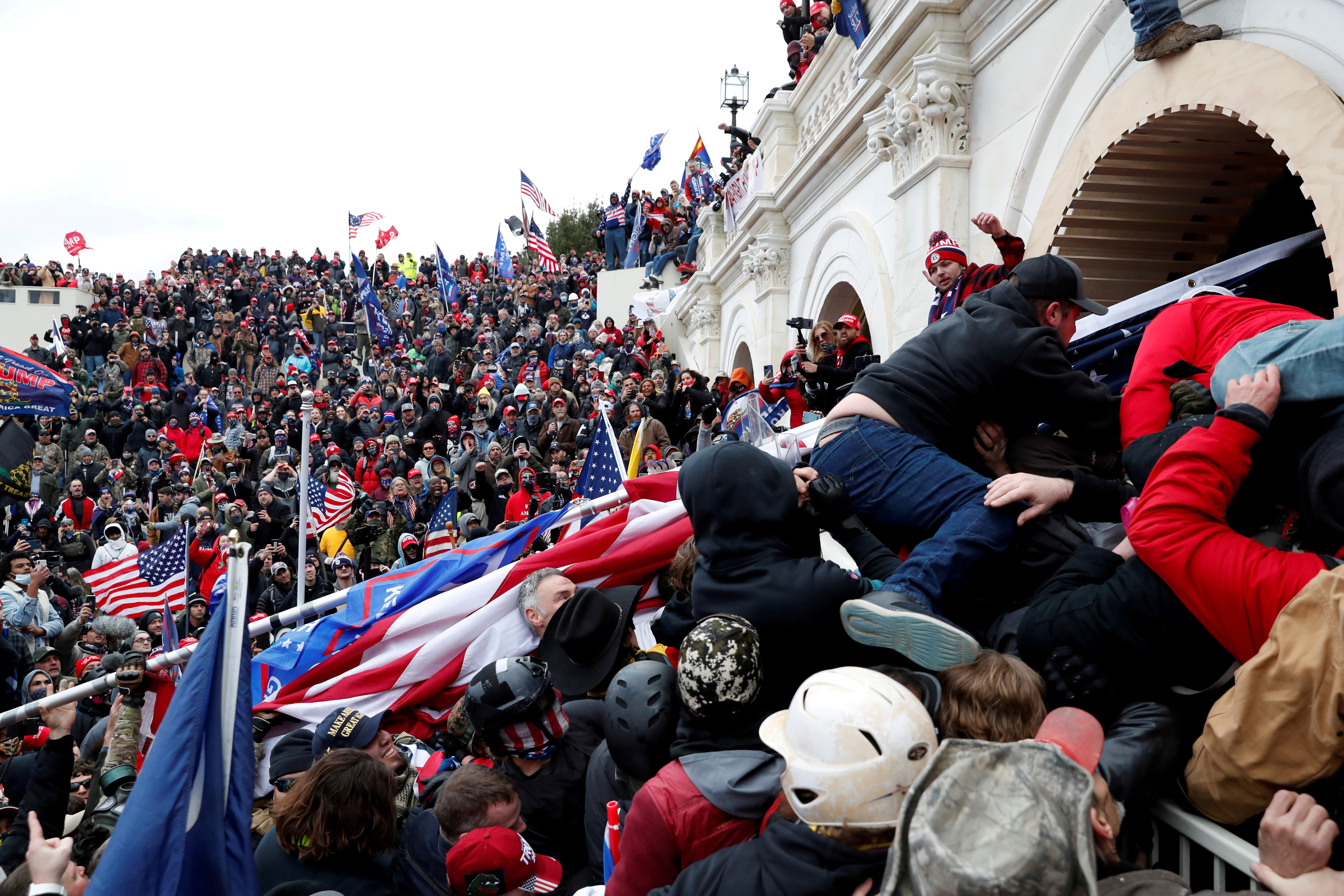 Pro-Trump protesters storm into the U.S. Capitol during clashes with police, during a rally to contest the certification of the 2020 U.S. presidential election results by the U.S. Congress, in Washington, U.S, January 6, 2021. REUTERS/Shannon Stapleton