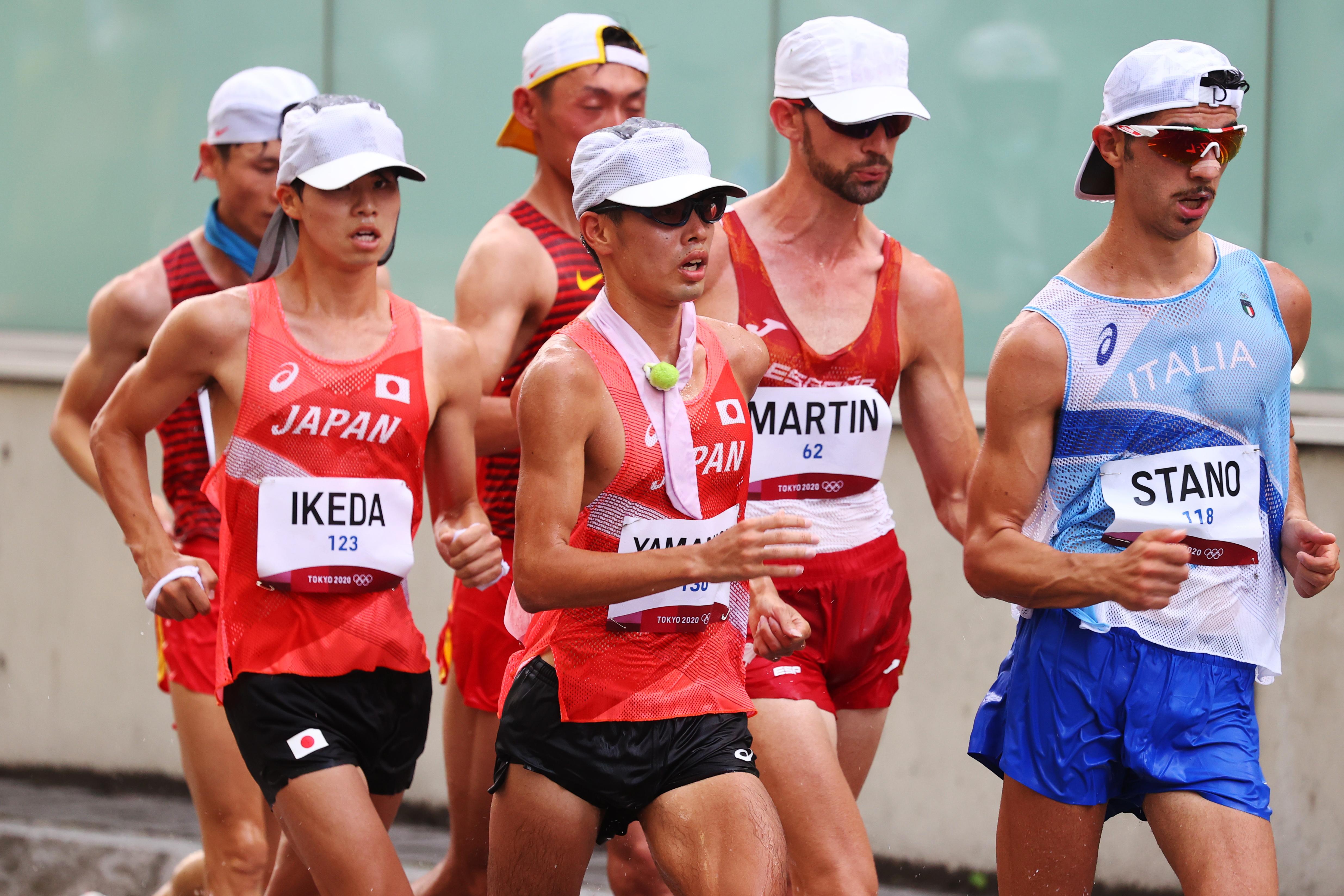 Tokyo 2020 Olympics - Athletics - Men's 20km Walk - Sapporo Odori Park, Sapporo, Japan - August 5, 2021. Koki Ikeda of Japan, Toshikazu Yamanishi of Japan and Massimo Stano of Italy in action during competing REUTERS/Kim Hong-Ji