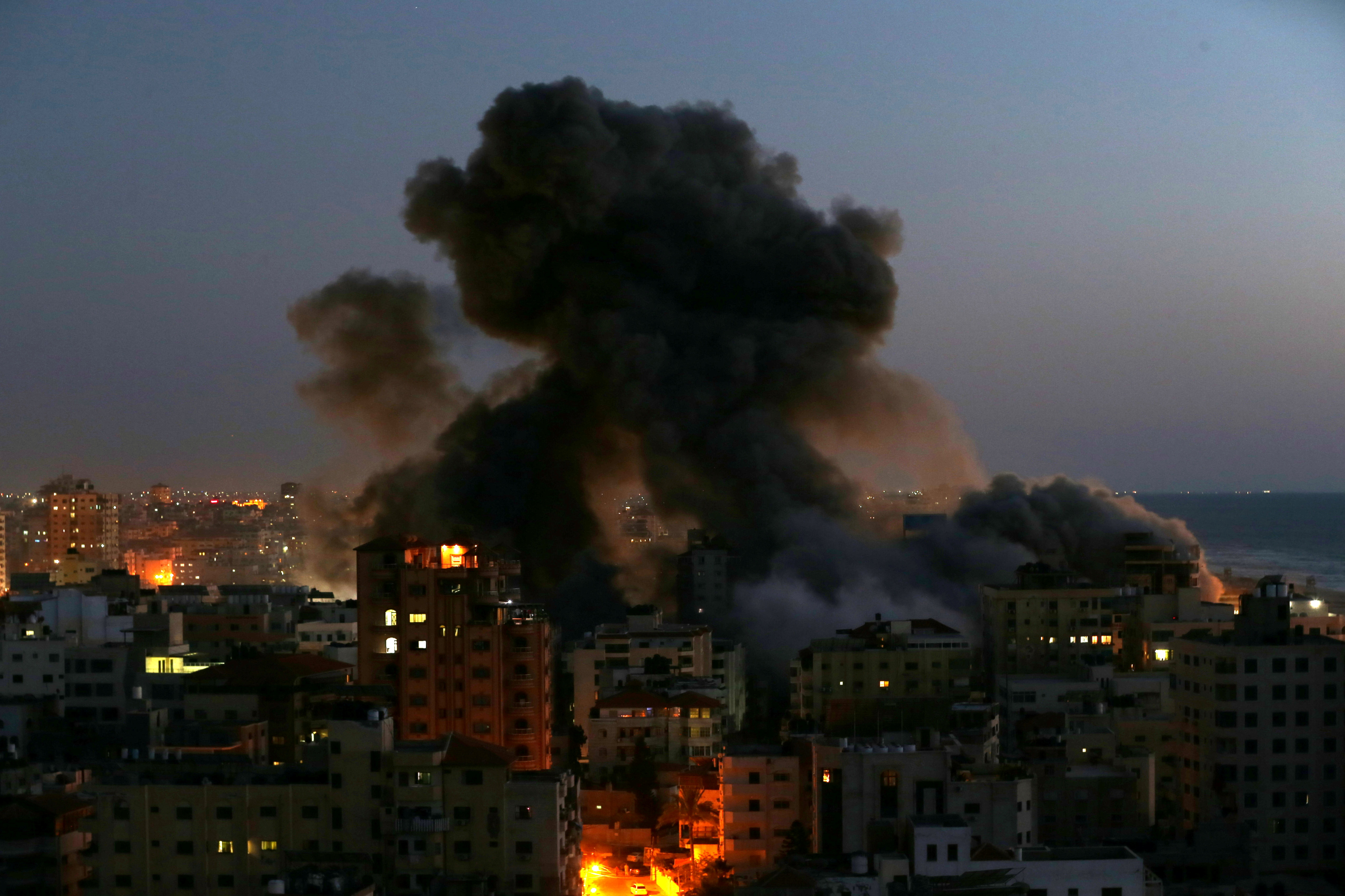 Smoke rises from a building after it was destroyed by Israeli air strikes amid a flare-up of Israeli-Palestinian violence, in Gaza May 11, 2021. REUTERS/Ibraheem Abu Mustafa